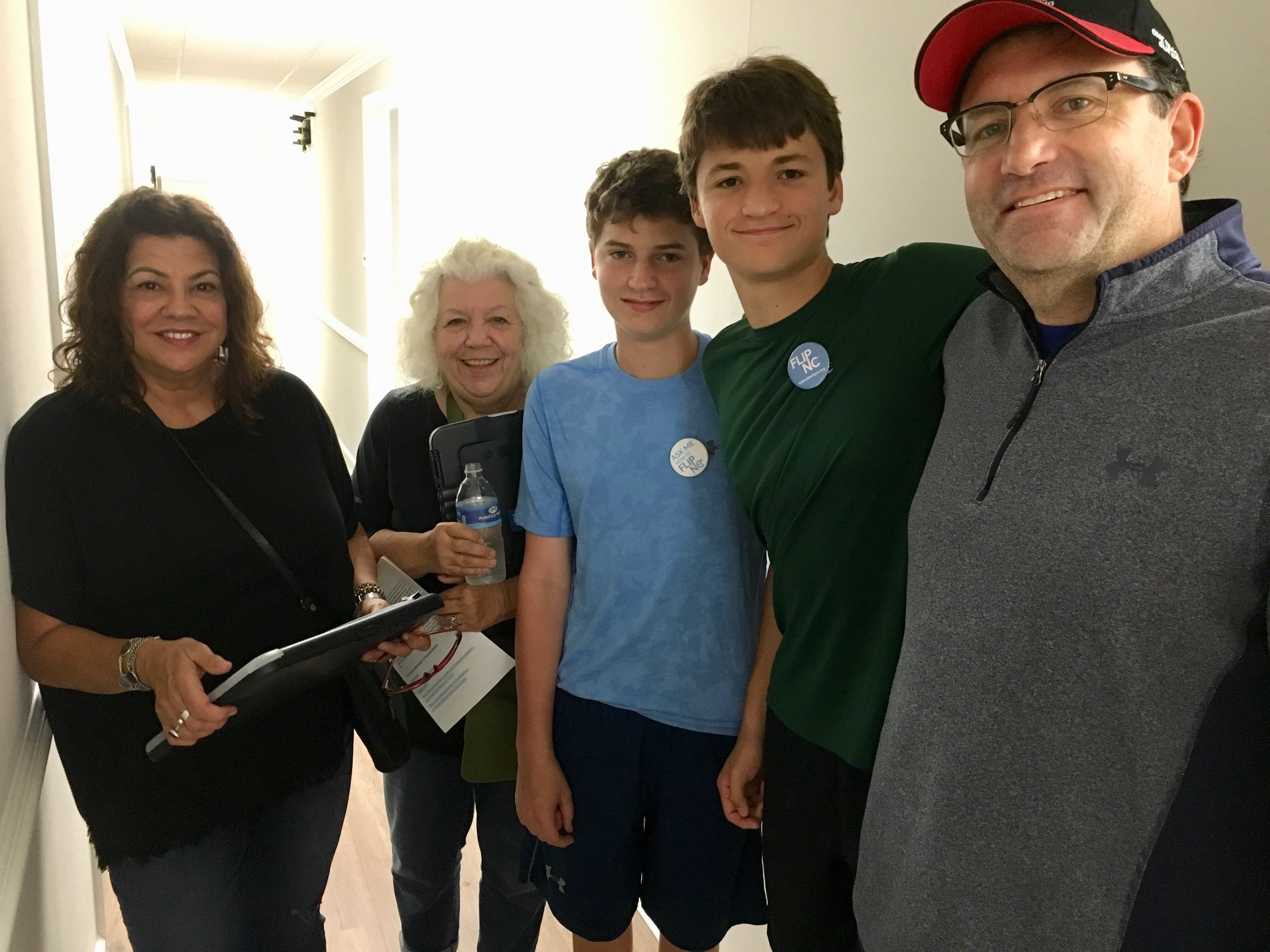 Canvassers Dana Carvalho and Nancy Spencer with Matt, Jake, and their dad