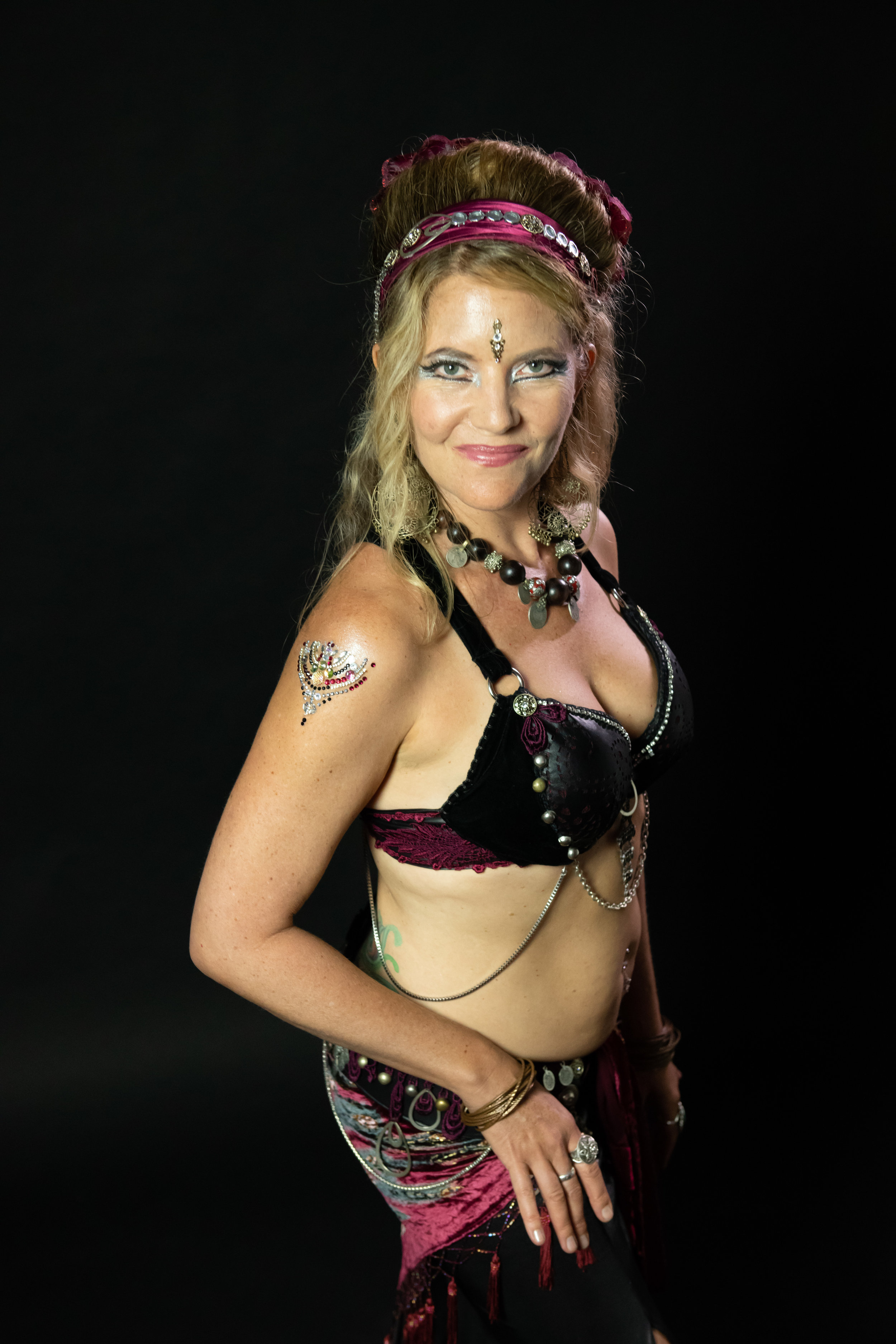 PAMELA SHERWOOD  Pamela brings over 30 years of dance experience and has an extensive background in Ballet, Tap, Modern and Jazz as well as a passion for salsa and ballroom dance. Tribal fusion belly dance entered into her life in Steamboat Springs, CO in 2009. Since then she has trained in various styles of belly dance including ITS, Improvisational Tribal Style, and has attended workshops with Rachel Brice, Lacey Sanchez, and Silvia Salamanca, to name a few favorites. She performed with Jasmir Belly Dance Troupe 2014-2016. She moved to Maui in 2016 and has been dancing and training with Lynette Day in Datura™ style as well as others. As a physical therapist since 1998 as well as a Certified Gyrotonic and Pilates Method Alliance Certified Pilates Teacher since 1999, she loves to watch the body move efficiently and her fascination with movement blends her work and passion for dance together.