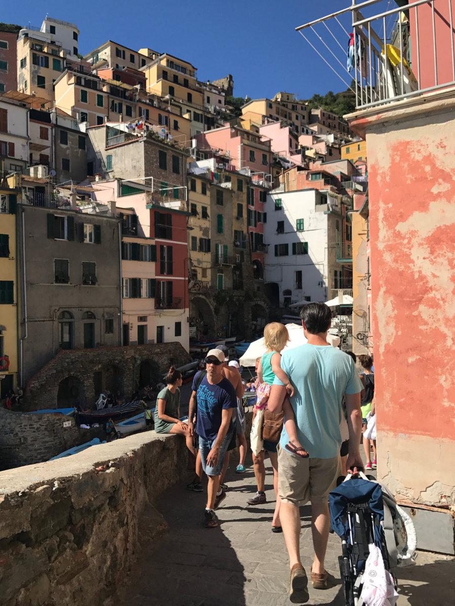Carrying the stroller around Riomaggiore.