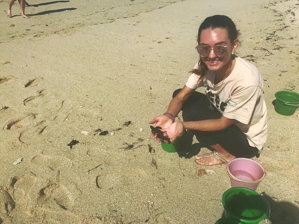 Olivia Releasing Baby Turtles Back To The Ocean