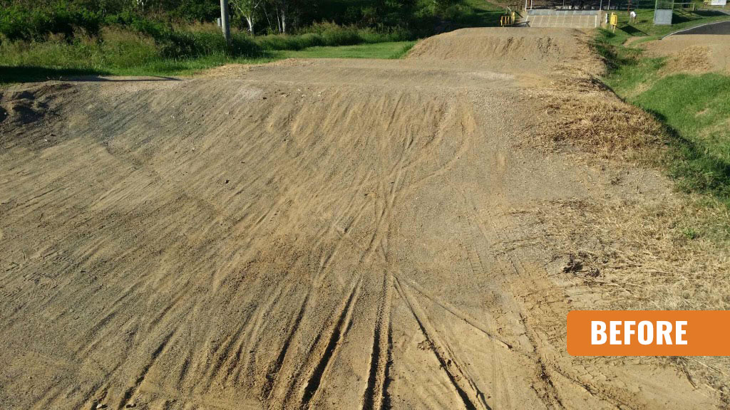 Damaged and wet BMX track that has not been seal