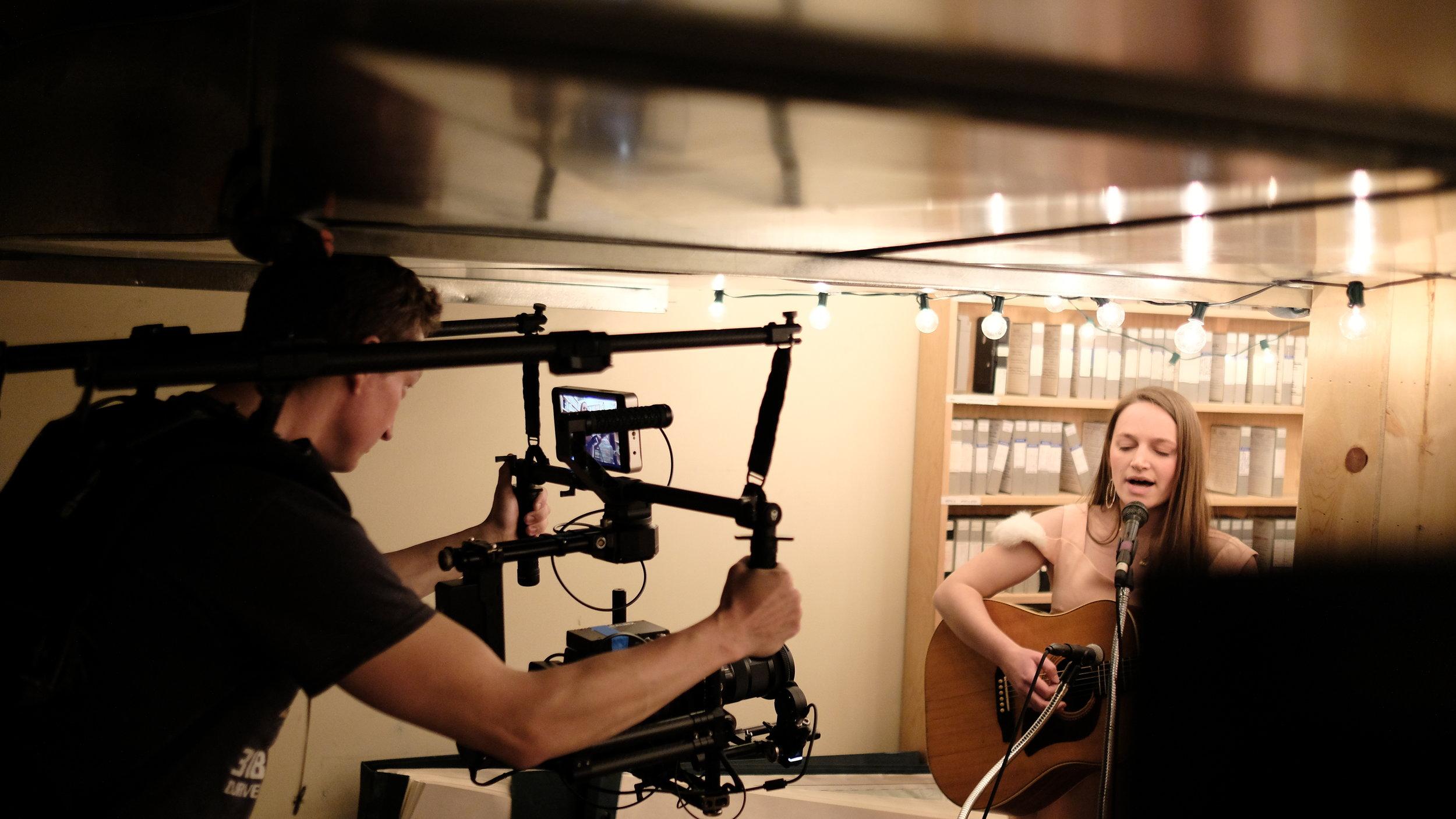 local videographer Brendan Preston on set with Calla Kinglit