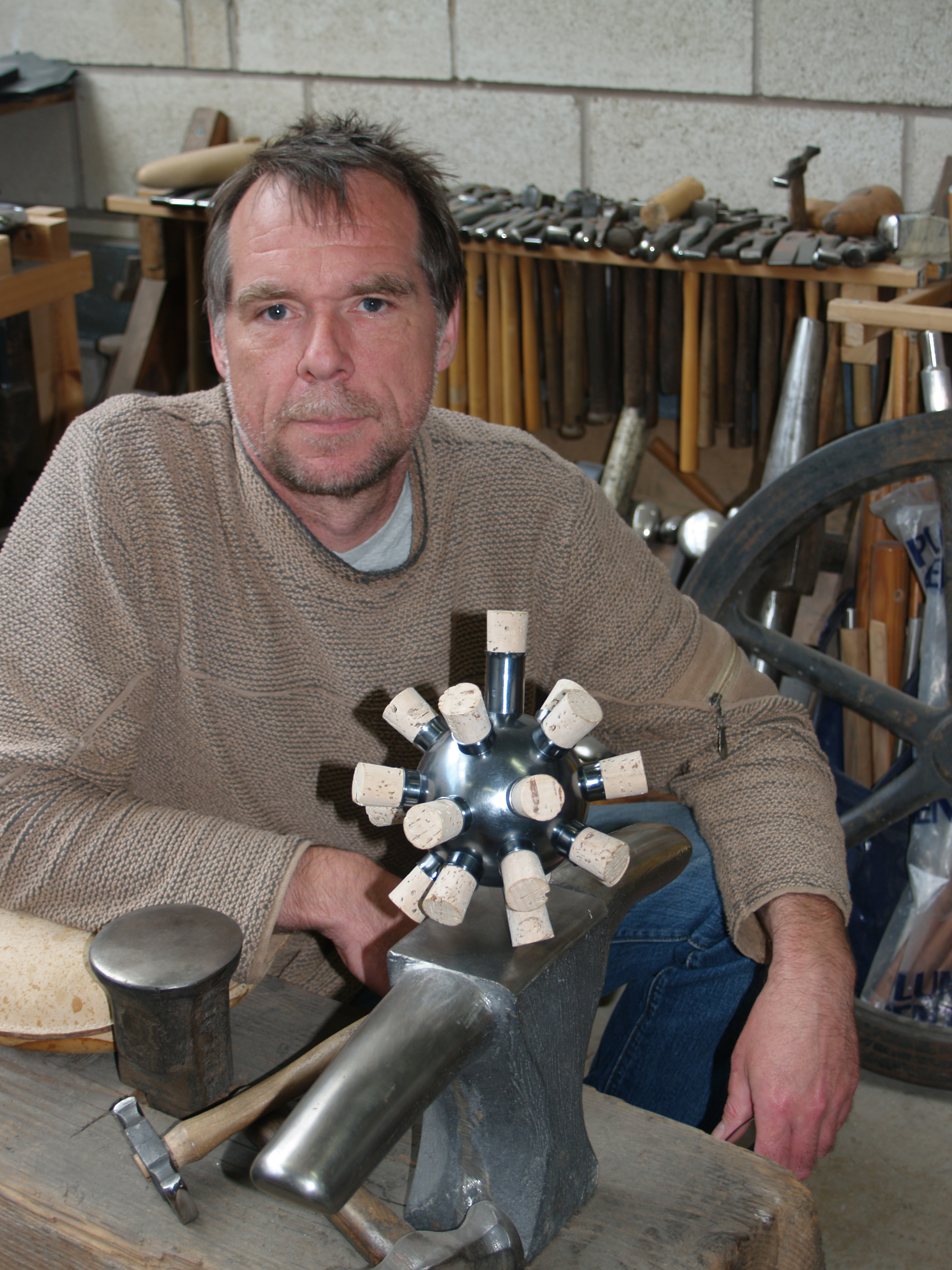 Chris Knight  - SHEFFIELD UK.Often working on the boundaries between art, craft and design, Chris Knight's pieces range from domestic, ecclesiastical and sporting silverware to architectural metalwork and public art.Having spent over 35 years working with metals, Chris has vast experience of fine metalwork in Silver, Bronze, Pewter and Steel, working on pieces from an intimate hand-scale to the monumental. The breath of this design and technical experience of working in metals informs both the work he makes within his own studio and that which he designs for production by manufacturers. Throughout his career Chris has embraced and generated opportunities to work creatively within a team. He has collaborated with silversmiths, product, interior and landscape designers, architects, artists, engineering companies, developers, town planners and city councils.Chris Knight is represented by Adrian Sassoon Adrian Sassoon