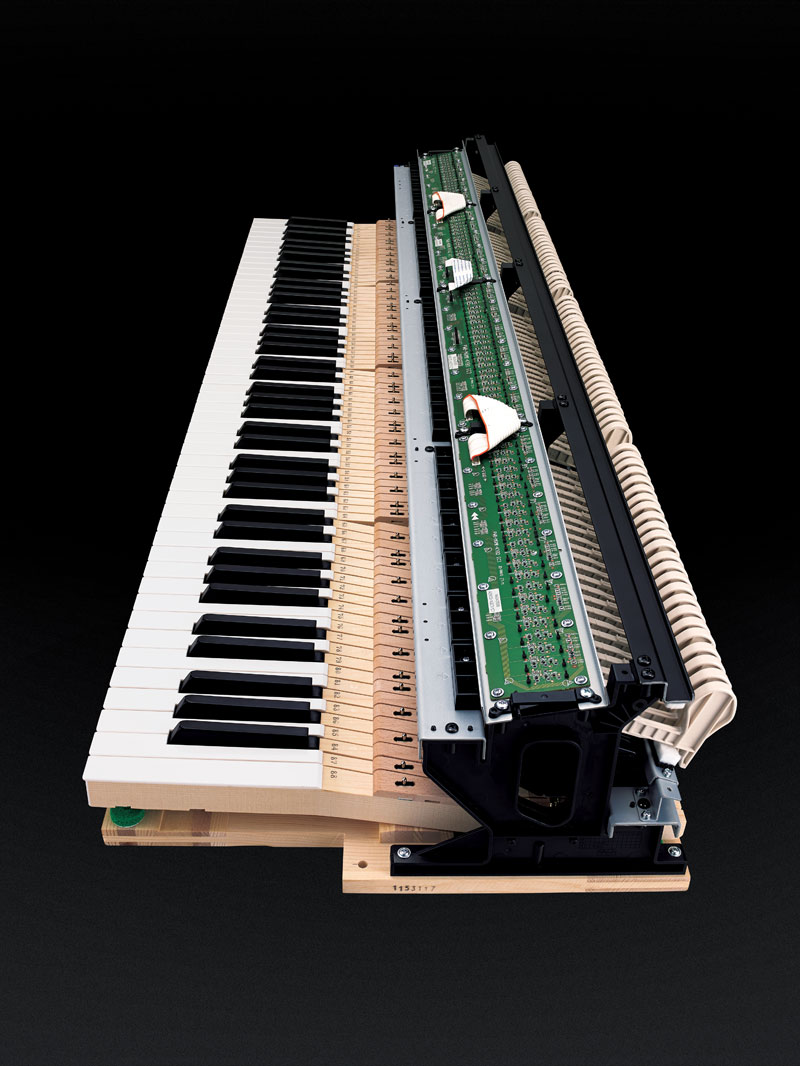 A perfect touch: Grand Hybrids use wooden keys and real, moving hammers.