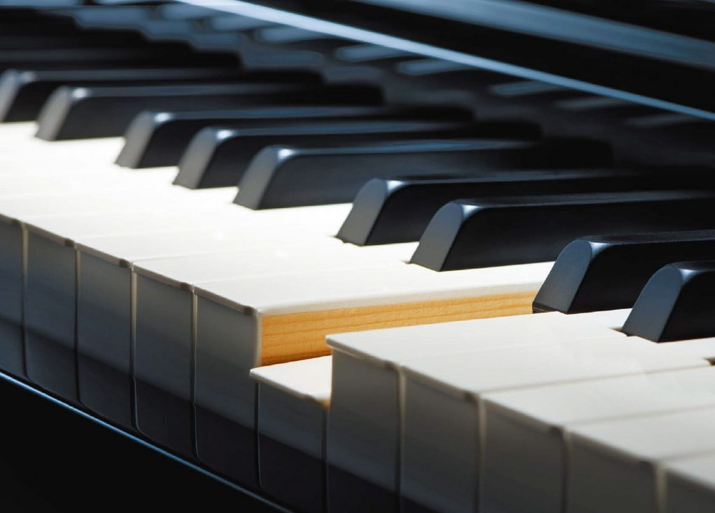 Hybrid pianos have full-length, wooden keys