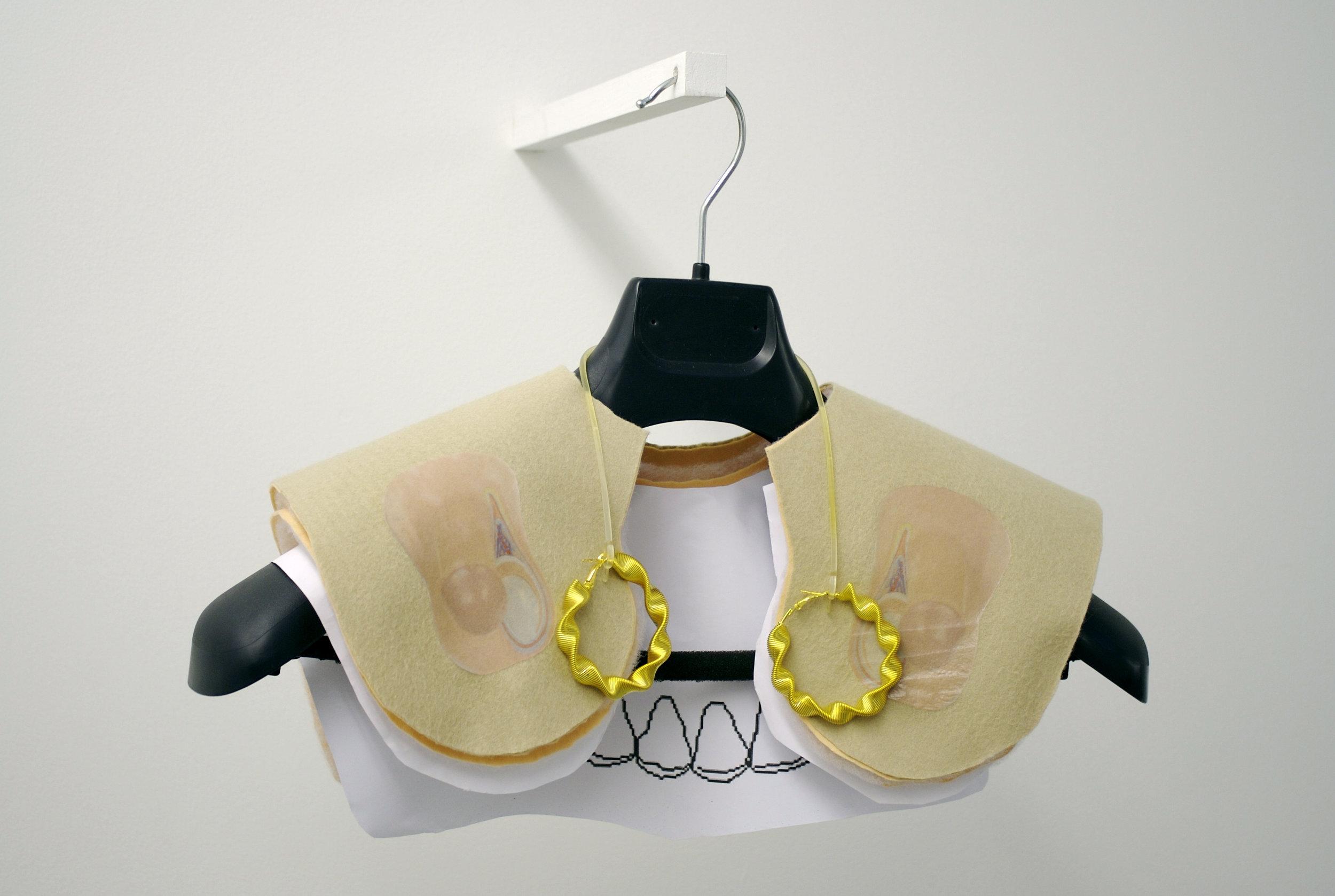 Bob Weight,  2011, Synthetic felt, Wadding, Digital print, Suit Hanger, Earings.