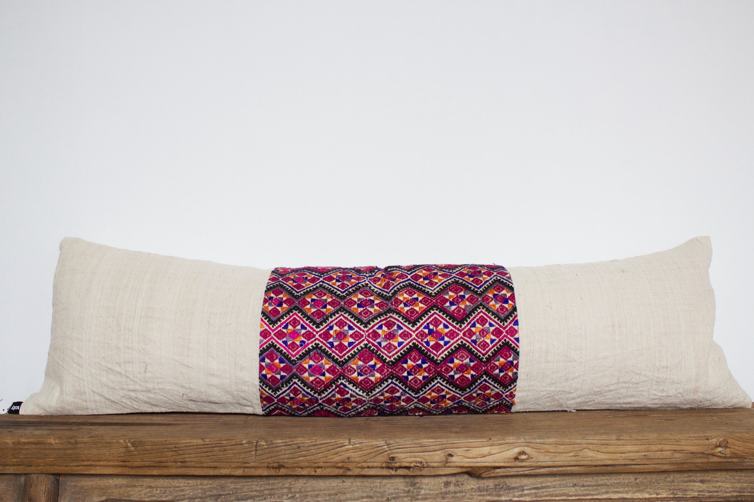 Eloise- No. 602   550 RMB  Pillow cover is made from hemp and vintage, embroidered fabric from in southern China  Size: Roughly 104x30 cm  Pillow back is made from a neutral cotton/linen blend  White zipper on bottom of pillow  Down insert included  Hand wash only
