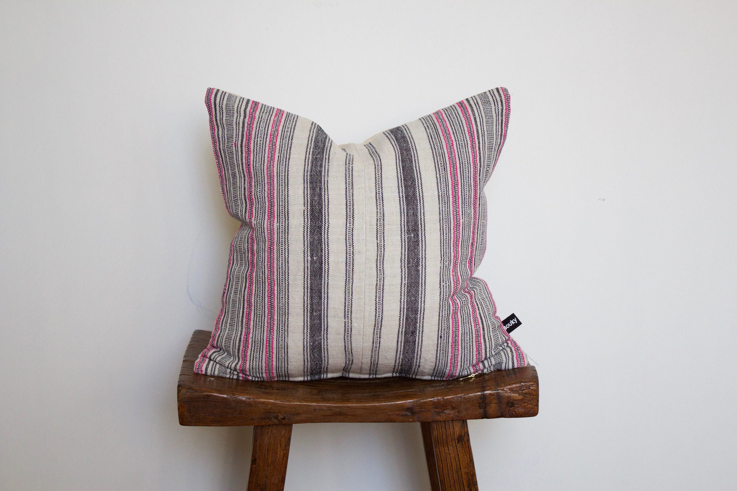 Finley - No. 143   275 RMB  Pillow cover is made from handwoven hemp fabric sourced from Northern Thailand  Size: Roughly 40x40 cm  Pillow back is made from a neutral cotton/linen blend  Zipper on bottom of pillow  Down insert included  Hand wash in cold water