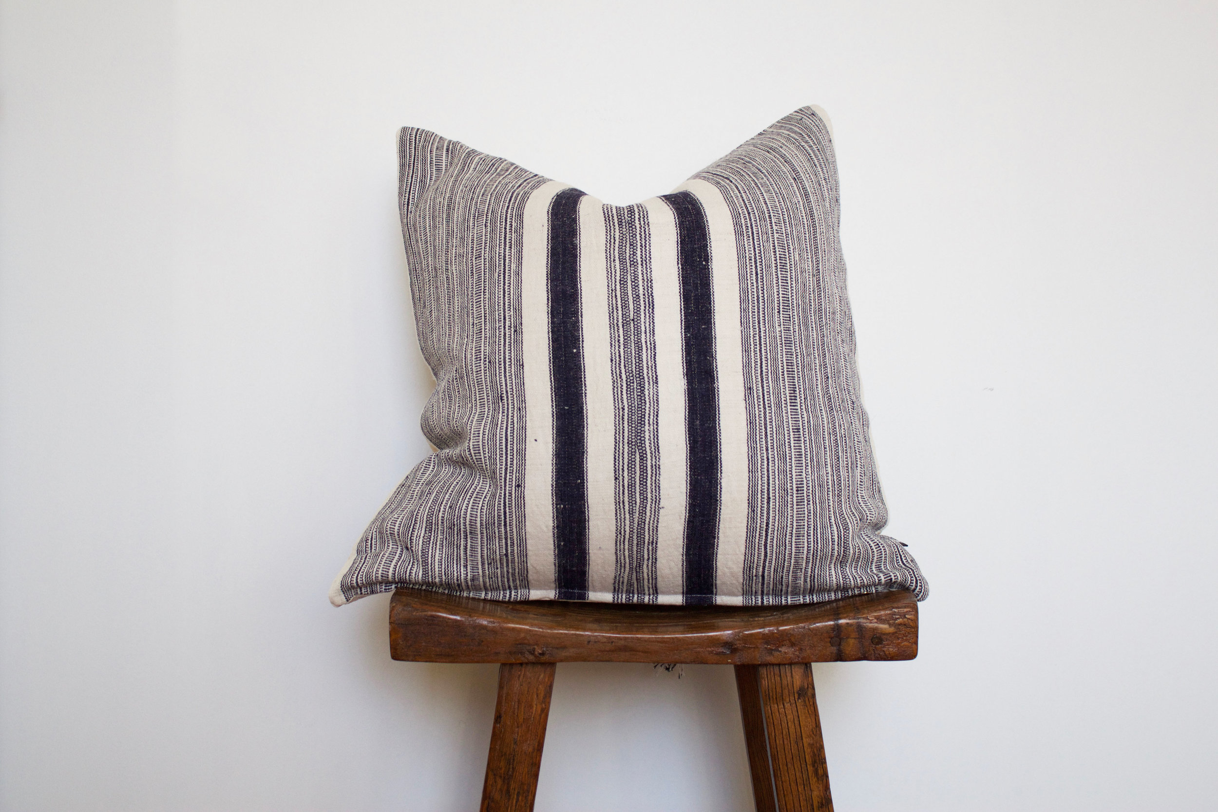 Tristen - No. 132   350 RMB  Pillow cover is made from handwoven hemp fabric sourced from Northern Thailand  Size: Roughly 50x50 cm  Pillow back is made from a neutral cotton/linen blend  Zipper on bottom of pillow  Down insert included  Hand wash in cold water