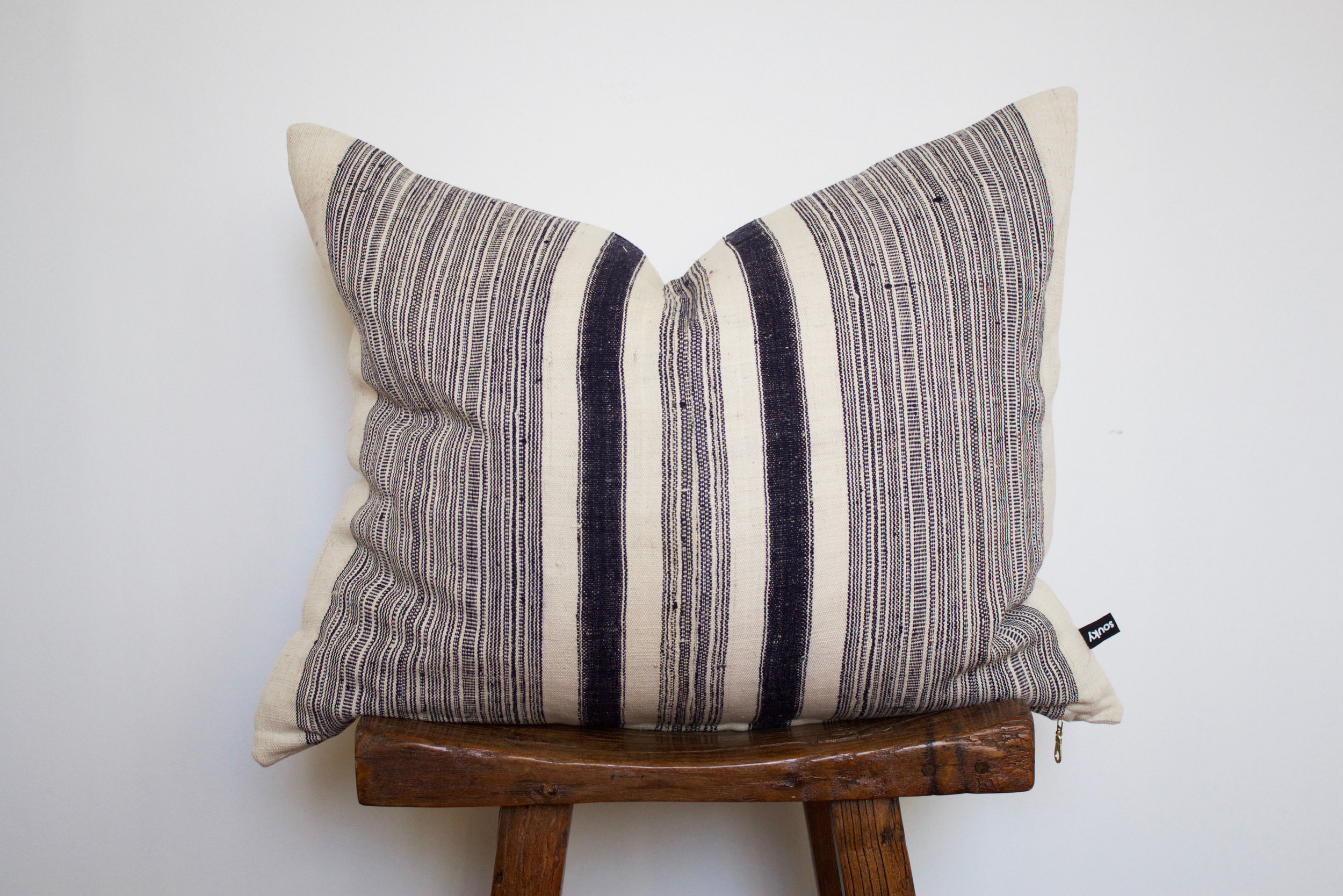 Tristen- No. 127   380 RMB  Pillow cover is made from handwoven hemp fabric sourced from Northern Thailand  Size: Roughly 60x50 cm  Pillow back is made from a neutral cotton/linen blend  Zipper on bottom of pillow  Down insert included  Hand wash in cold water