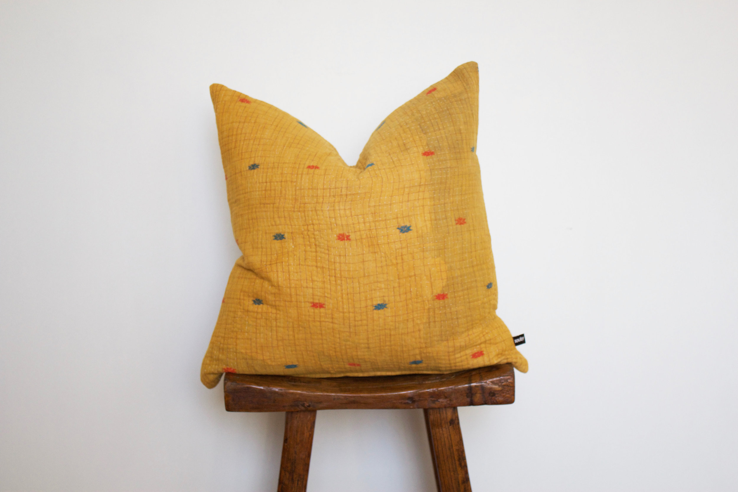 Mila - No. 214   300 RMB  Pillow cover is made from worn sari fabric sourced from India  Size: Roughly 50x50 cm  Pillow back is made from a neutral cotton/linen blend  Zipper on bottom of pillow  Down insert included  Dry clean only