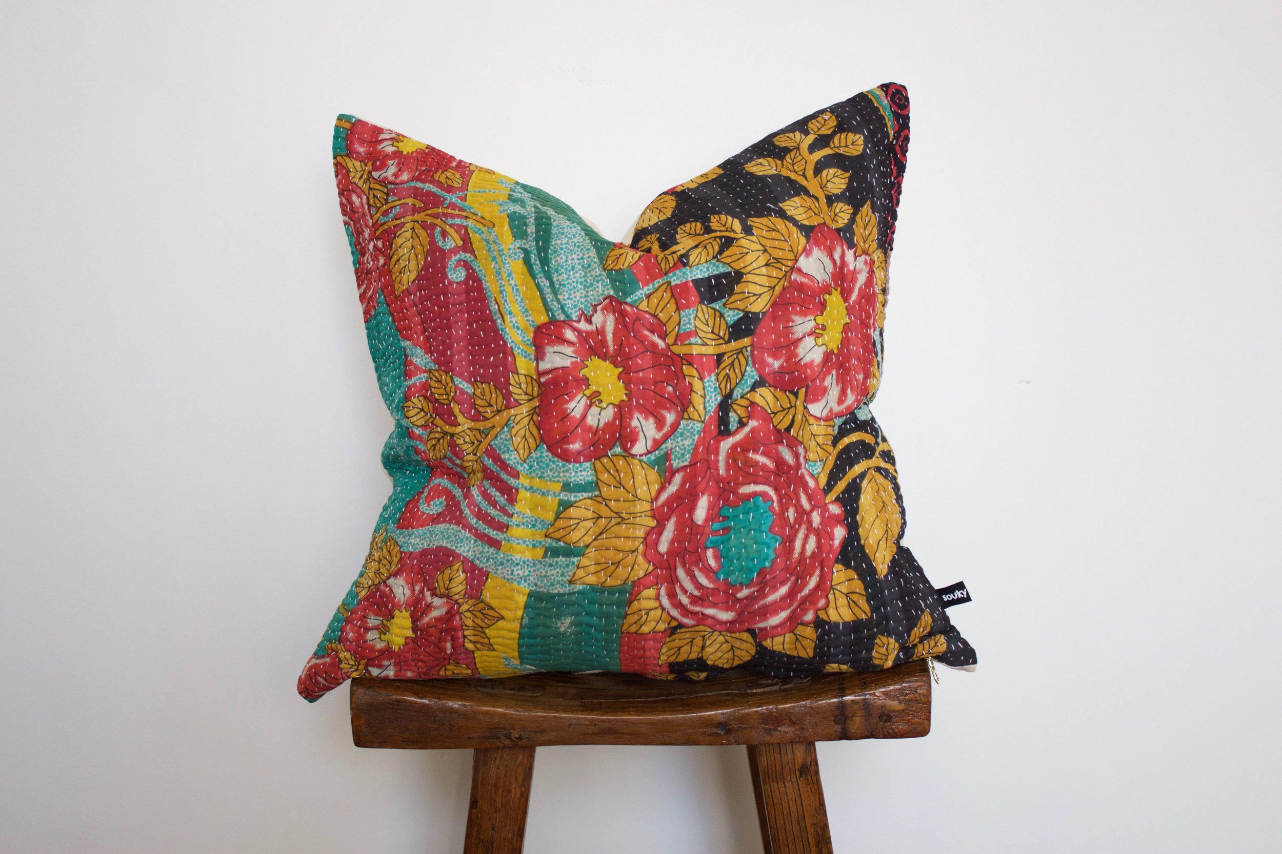 Rosie - No. 220   300 RMB  Pillow cover is made from worn sari fabric sourced from India  Size: Roughly 50x50 cm  Pillow back is made from a neutral cotton/linen blend  Zipper on bottom of pillow  Down insert included  Dry clean only
