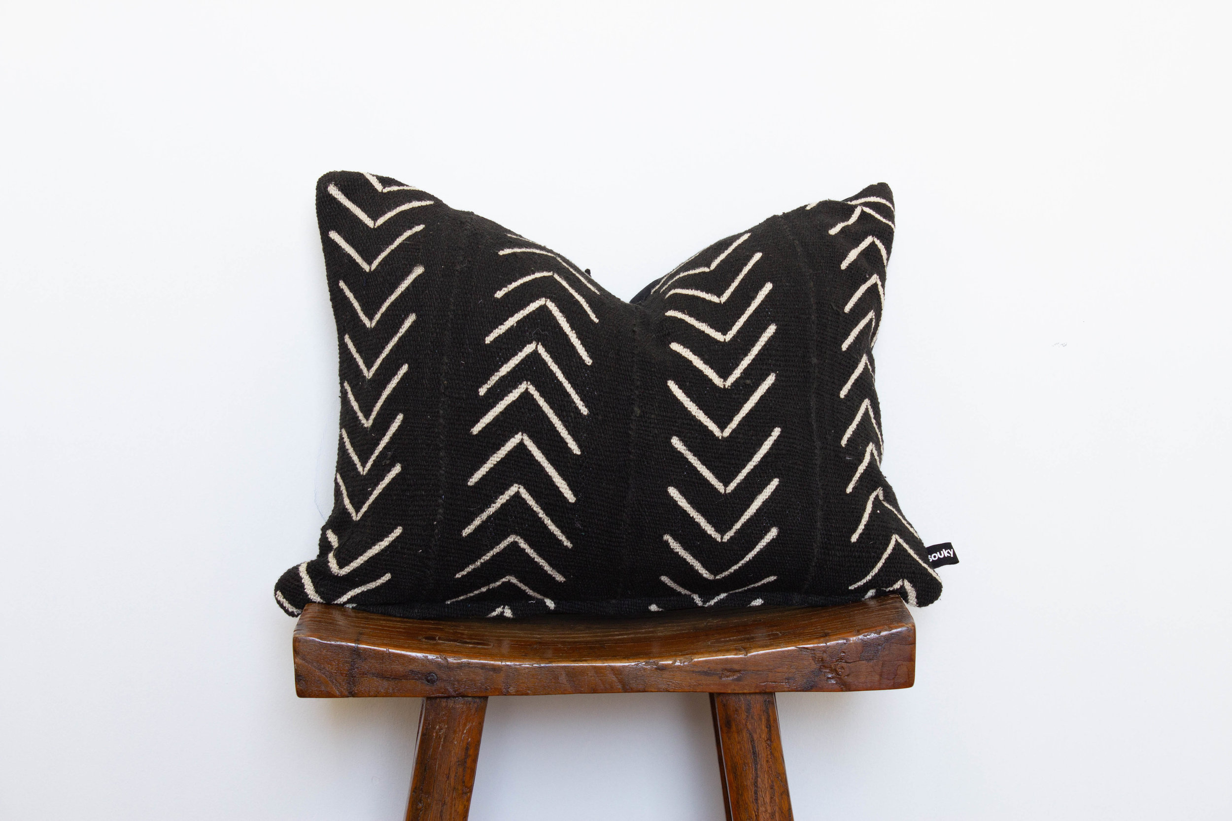 Brenna- 1 available    320 RMB  Pillow cover is made from black African mud-cloth sourced from west Africa  Size: Roughly 49x35 cm  Pillow back is made from a neutral cotton/linen blend  Zipper on bottom of pillow  Down insert included  Hand wash or spot clean recommended
