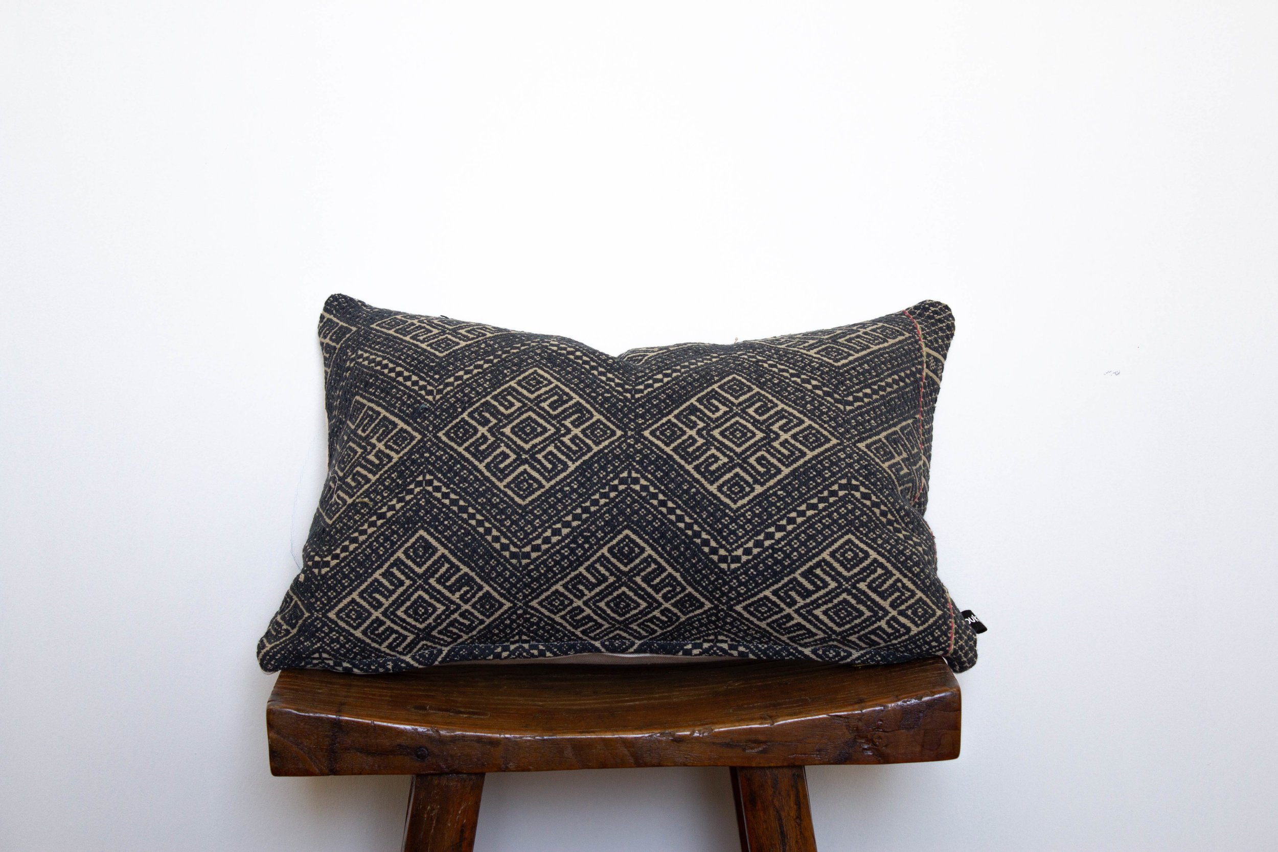 Jenna-1 available    400 RMB  Pillow cover is made from vintage, embroidered fabric sourced from southern China  Size: Roughly 46x30 cm  Pillow back is made from a neutral cotton/linen blend  Zipper on bottom of pillow  Down insert included  Hand wash or spot clean recommended