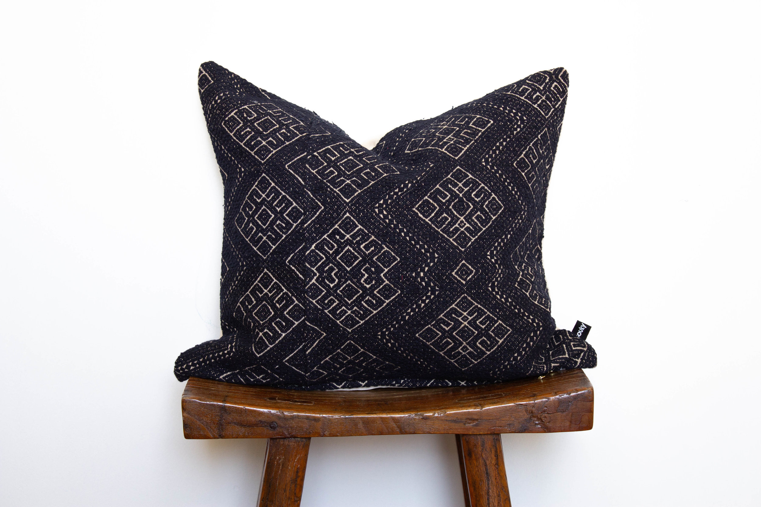 Kelsey- 1 available   450 RMB  Pillow cover is made from vintage, embroidered fabric sourced from southern China  Size: Roughly 46x43 cm  Pillow back is made from a neutral cotton/linen blend  Zipper on bottom of pillow  Down insert included  Hand wash or spot clean recommended