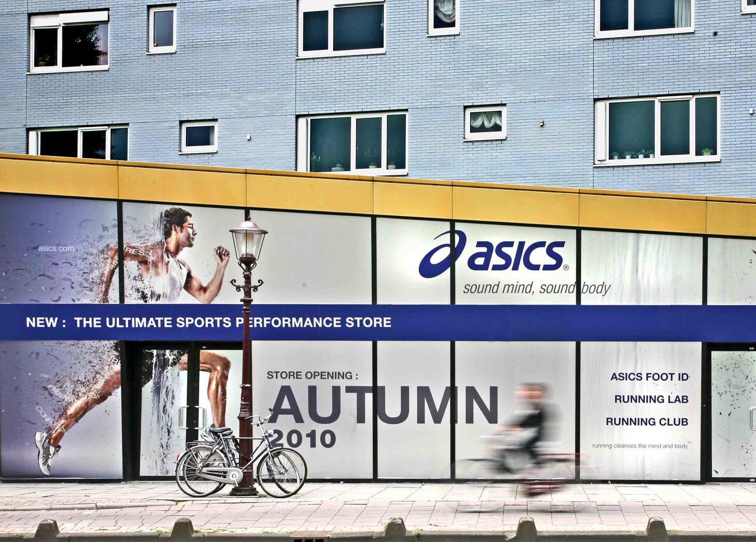 Large-format exterior hoarding graphics at ASICS' Amsterdam flagship store