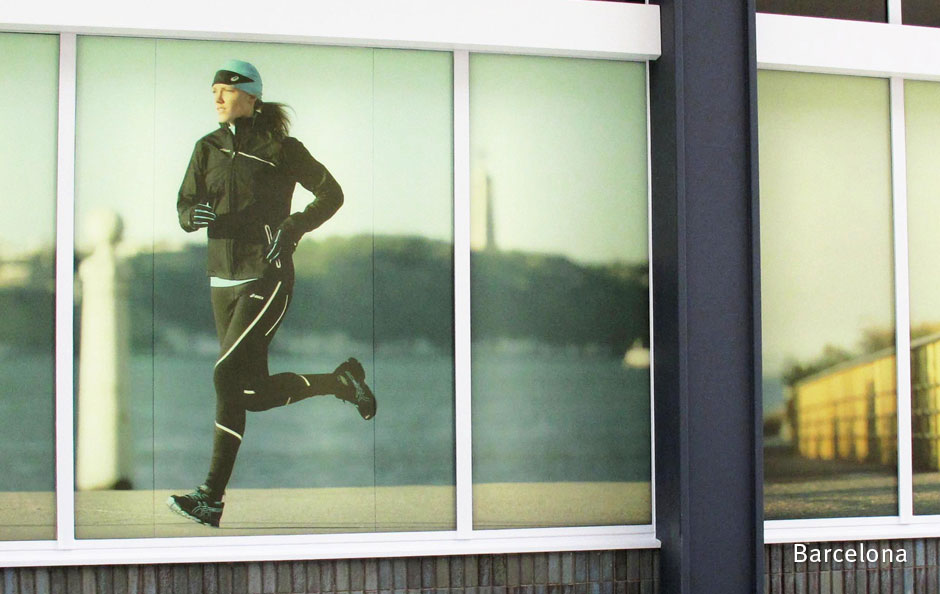 Large-format exterior hoarding graphics at ASICS' Barcelona flagship store