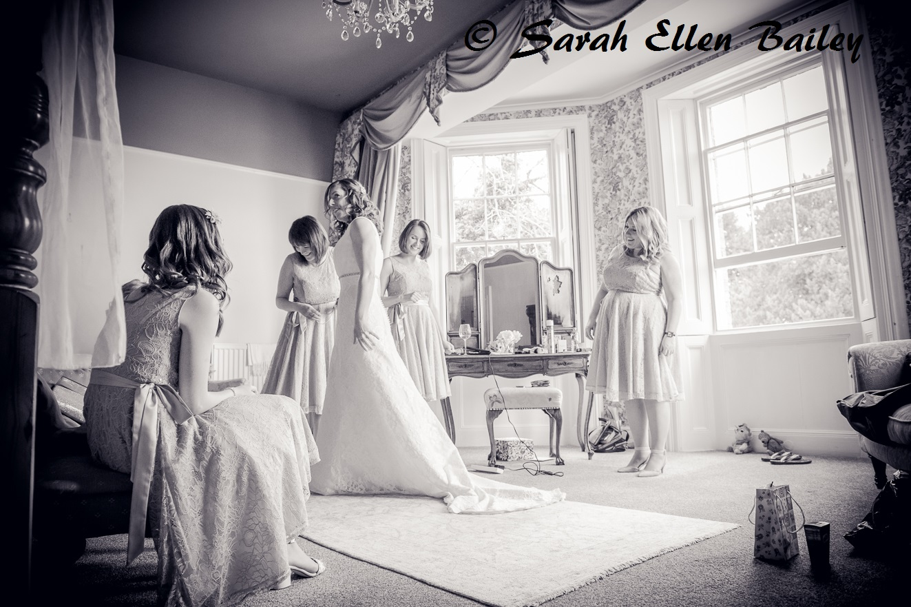 Bride and bridesmaids getting ready in the bridal suite at Skendleby Hall