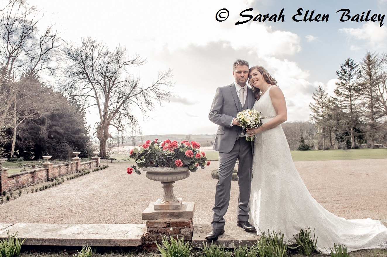 Bride and Groom wedding photograph overlooking the view from Skendleby Hall