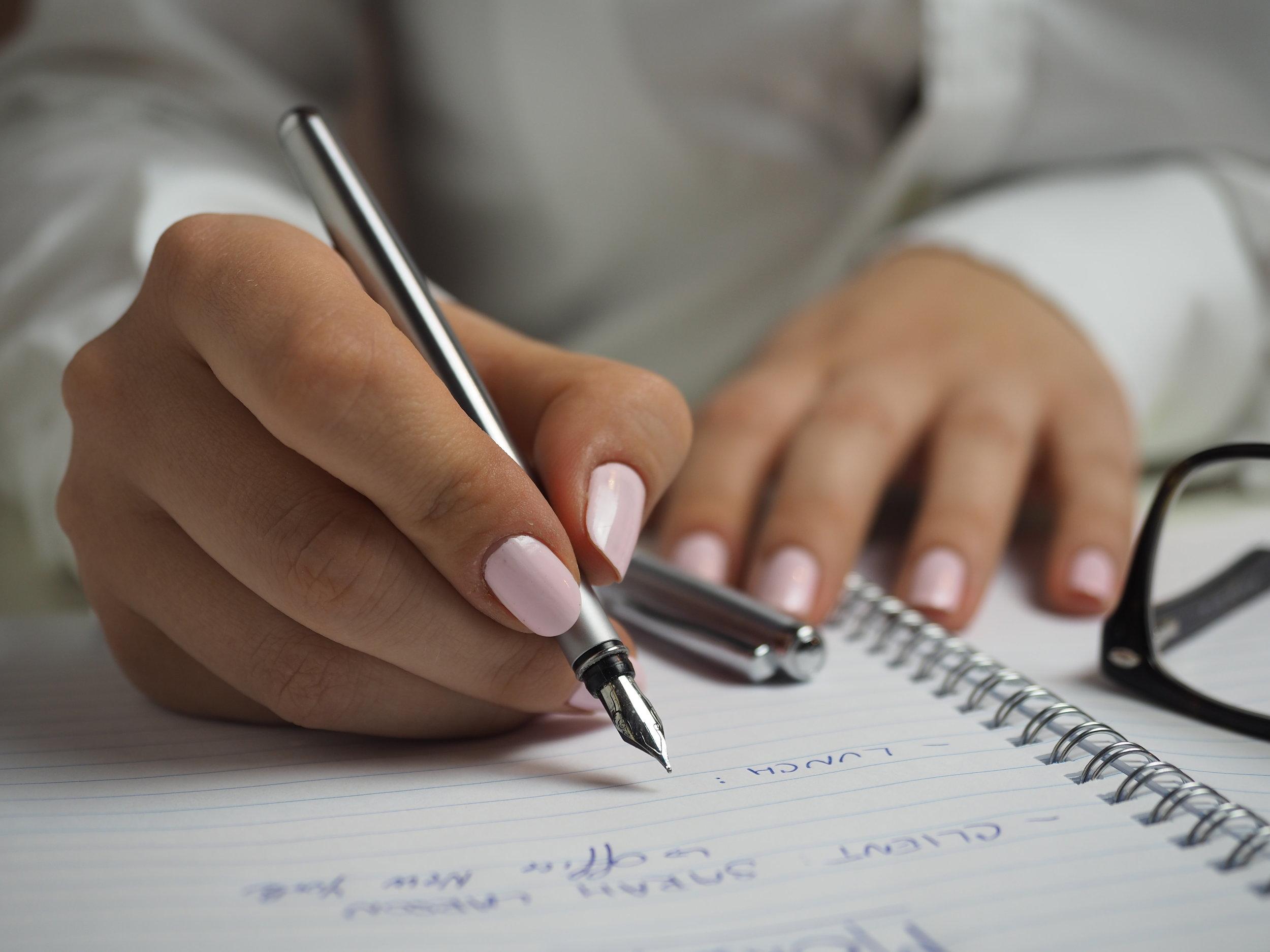 notebook-writing-work-hand-pen-finger-921425-pxhere.com.jpg