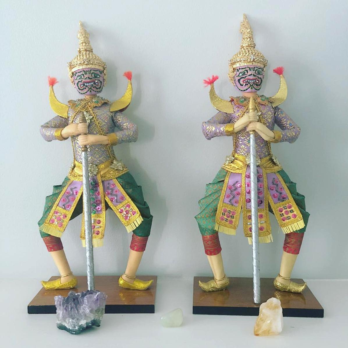 thai massage with yaksha statues
