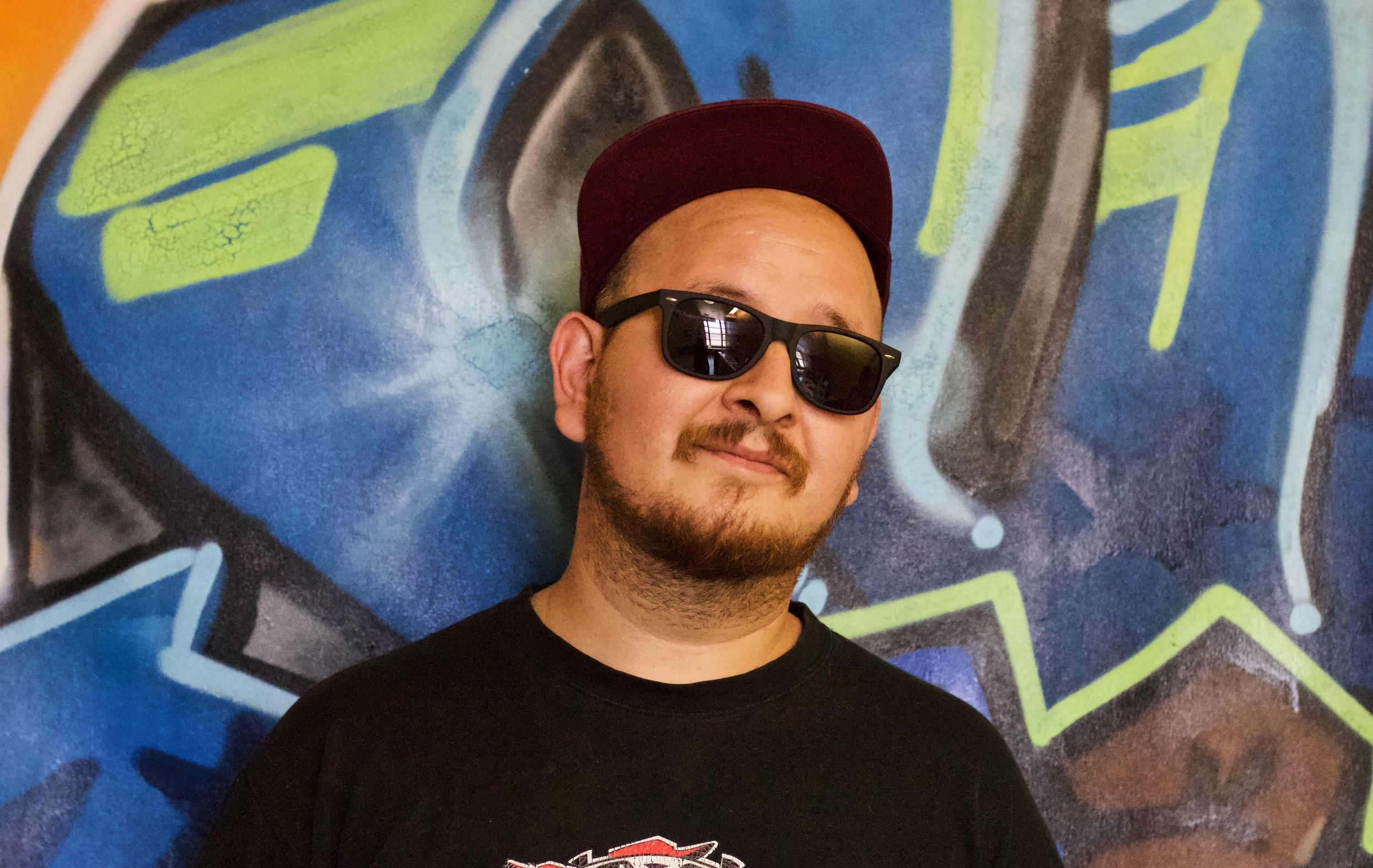 "Joshua ""Kenzo"" Aldrete has been a hip-hop D.J. for over twelve years. His artistic work also includes graphic design, visual arts instruction, and photography, all of which he has shared with J.U.i.C.E. participants for over six years. Mr. Aldrete attended Art Center of Design in Pasadena, CA. He was an art facilitator for the LAUSD Ambassador School project, and currently educates participants in DJing skills. Mr. Aldrete is a master at building bridges and expanding relationships with other artists and organizations, and his professional network has kept J.U.i.C.E. and its artists in people's minds. Since his work at J.U.i.C.E. began, he has been dedicated to supporting artists and their work to grow and flourish. As a leading organizer in the community one of the most recent accomplishments has been his directorship role as one of the primary organizers for the LA Zine Fest that brought together over 2,000 independent publishers. Mr. Aldrete will be responsible for organizing instructors and developing the DJ teaching series. In addition he will be responsible for outreach to local organizations in the community to introduce the video teaching series."