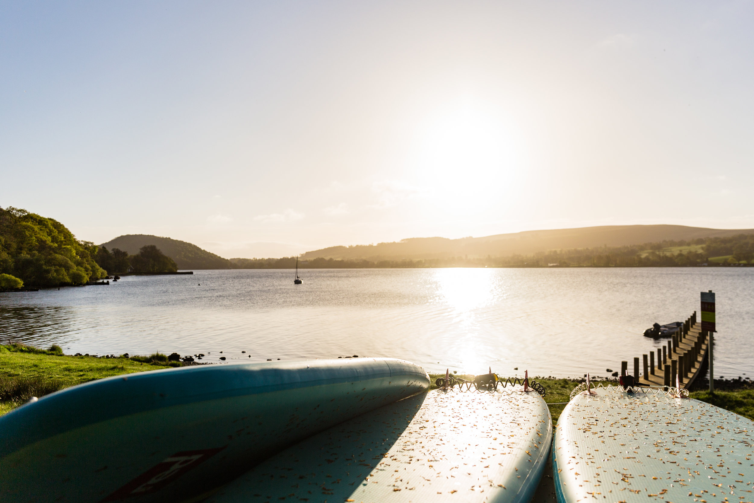 Stand-up Paddleboards to hire on beautoful Ullswater in the early morning light