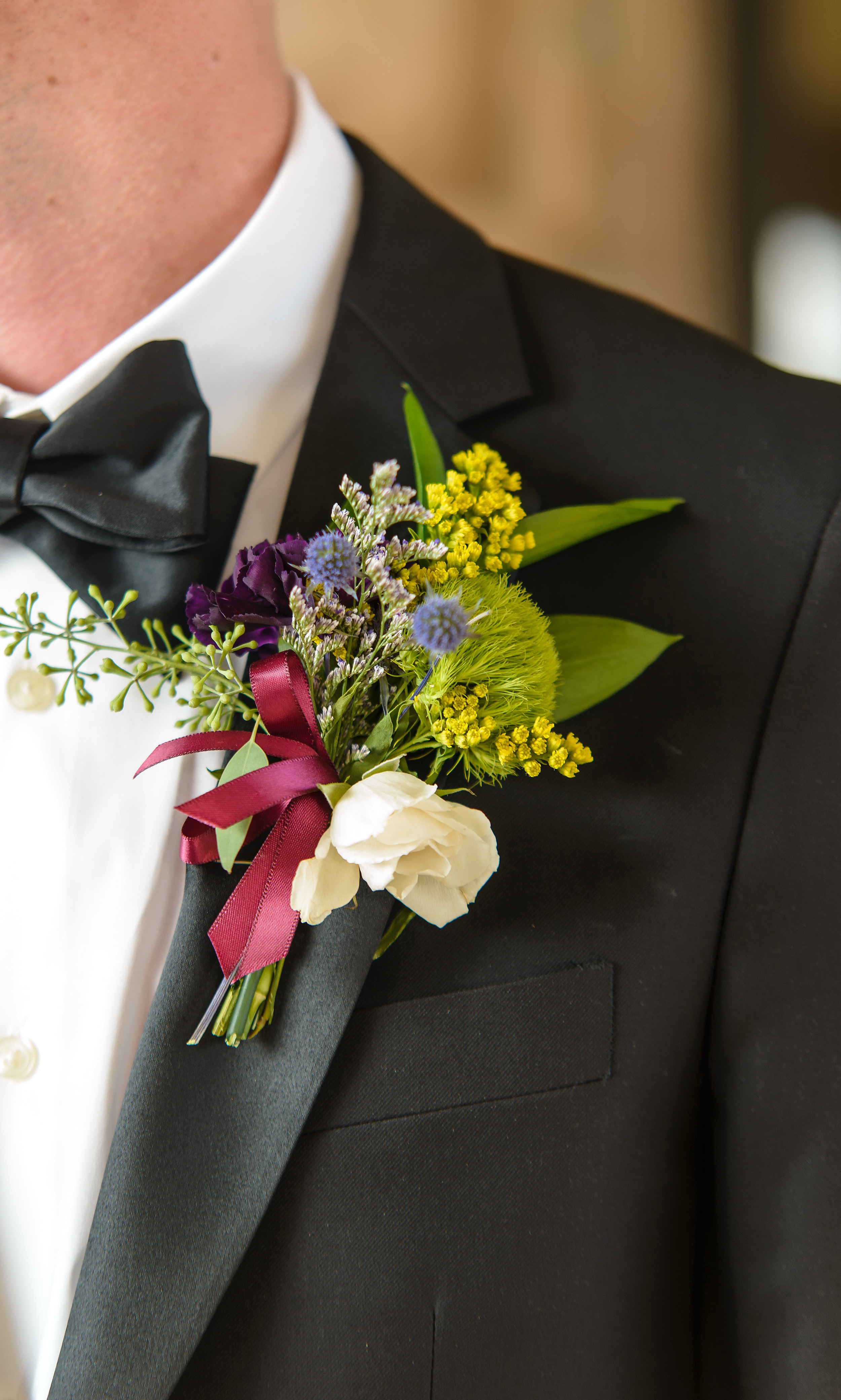 Photographer in OKC Boutonniere Paisley and Peonies The Palace Event Center