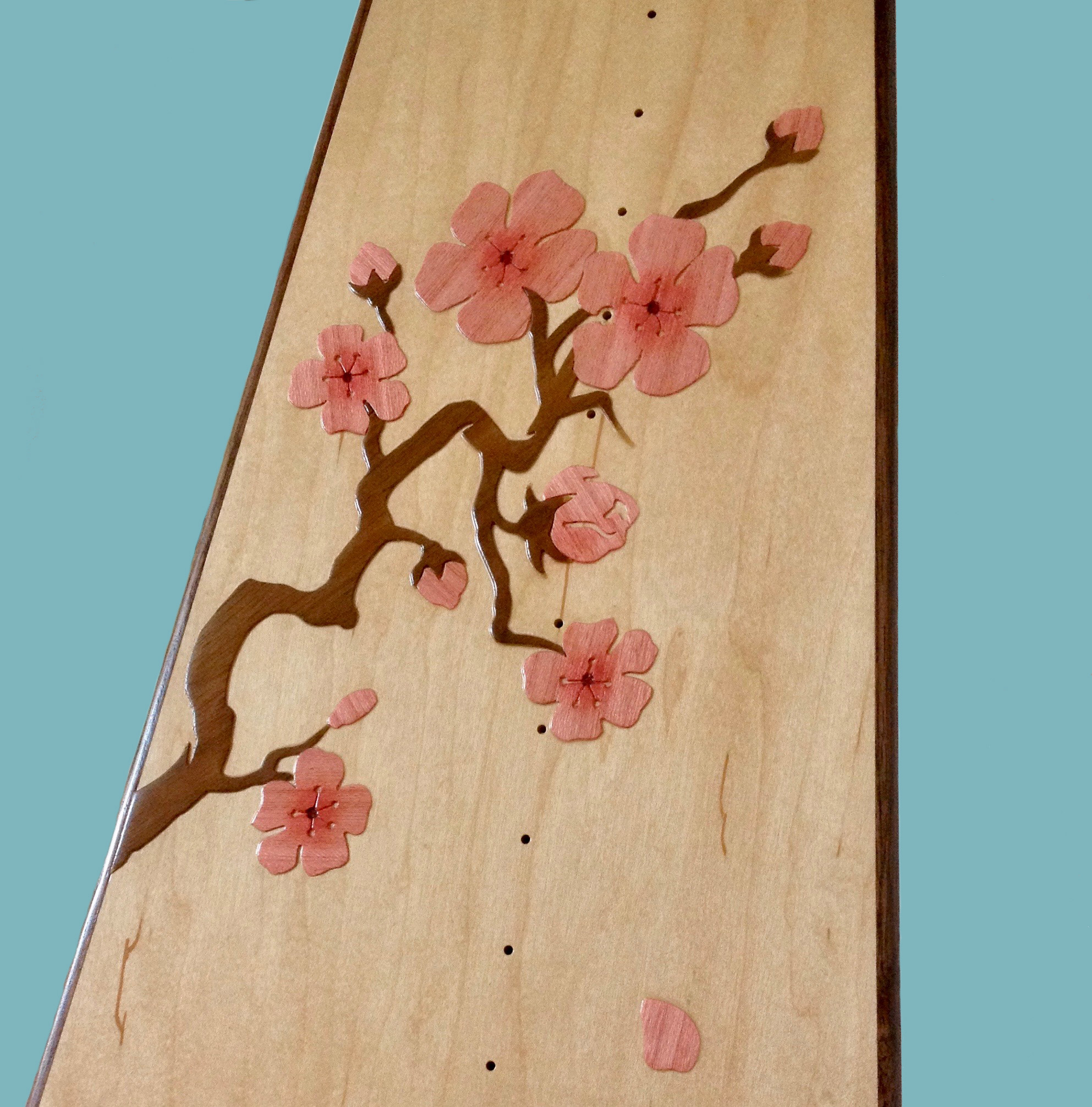 The Cherry Blossom ornamentation is one of the possible selections in the standard Rees catalog.