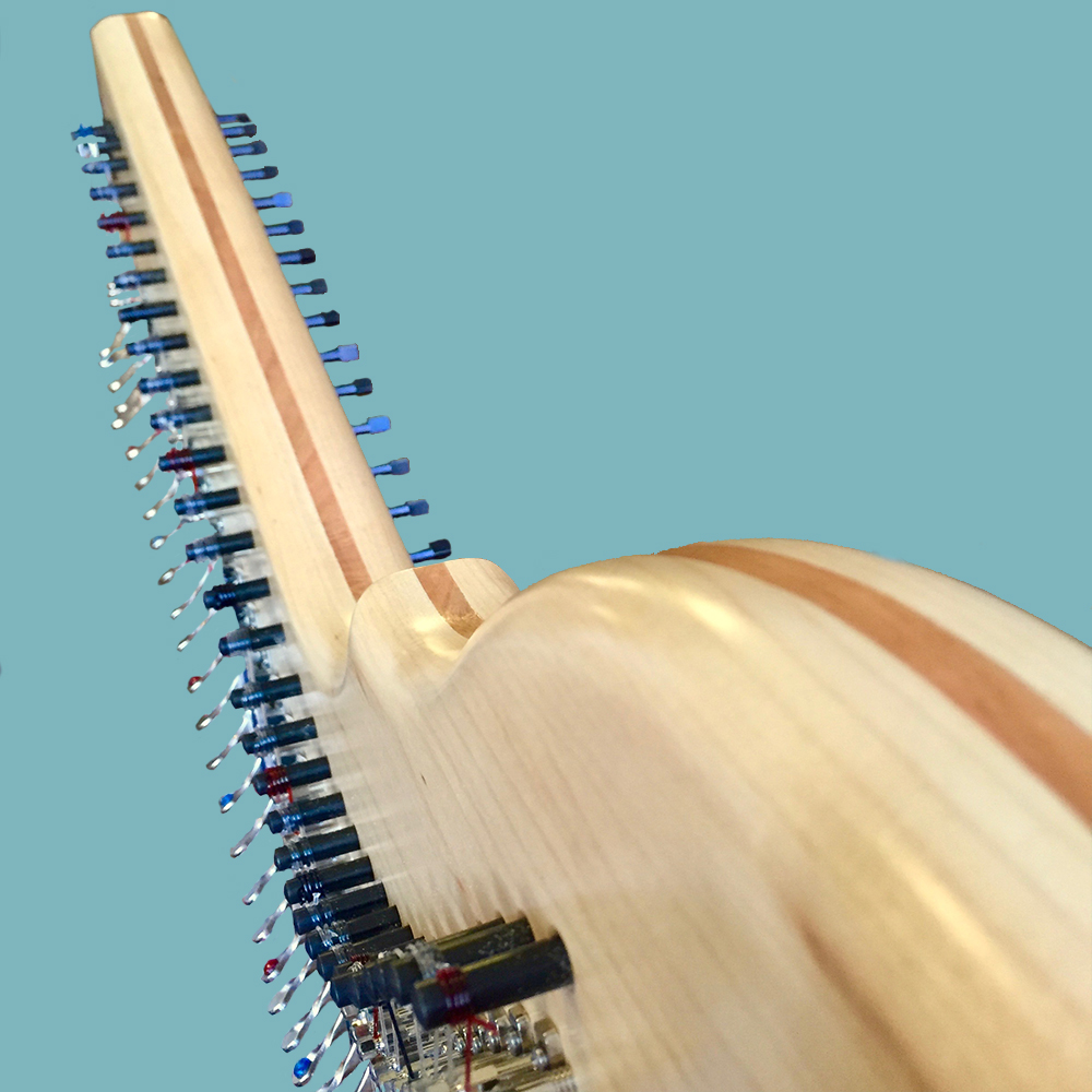 A maple, cherry, maple hardwood laminate Rees Harps harmonic arch.