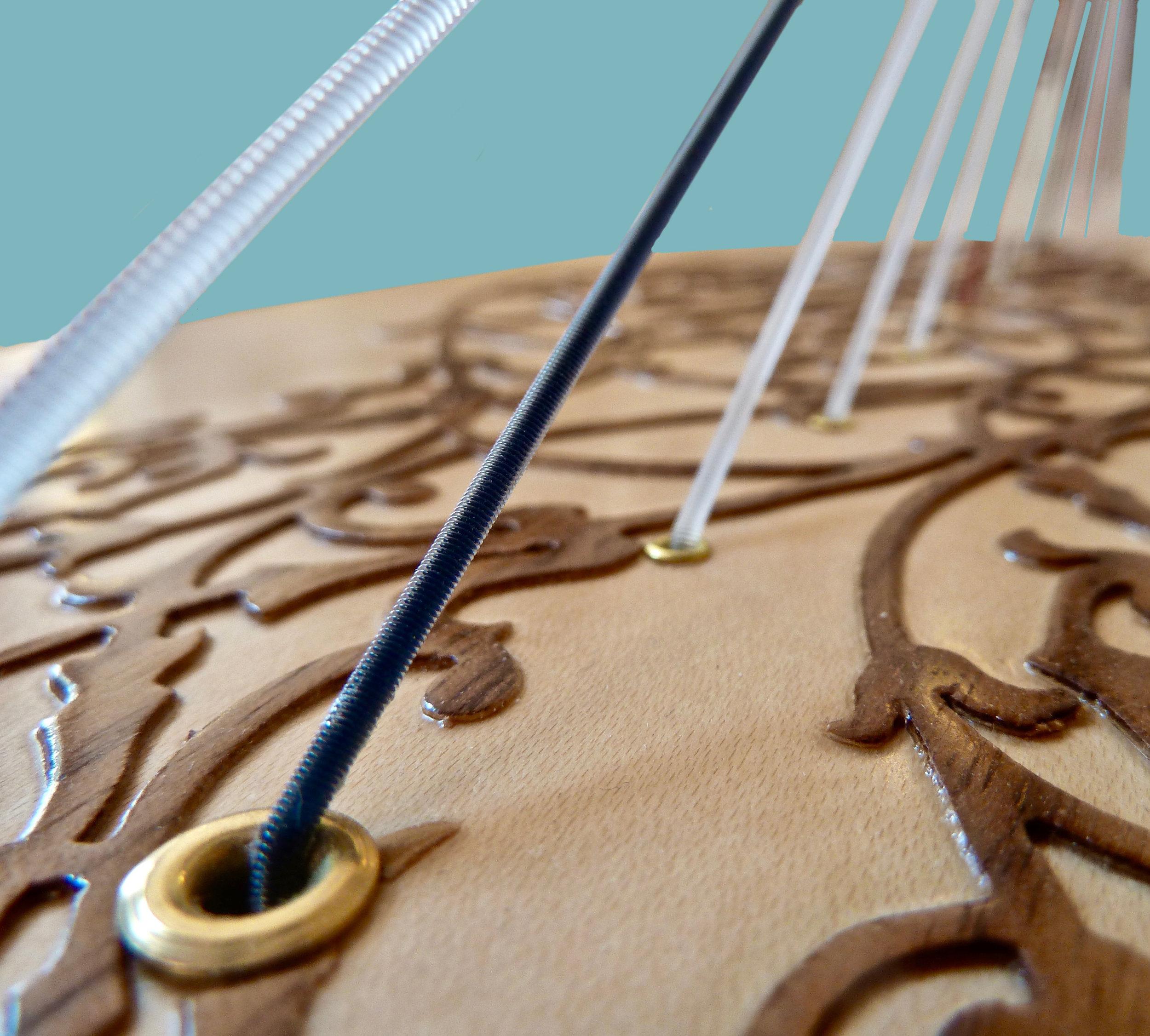 A Rees poplar soundboard with a maple veneer and walnut ornamentation.