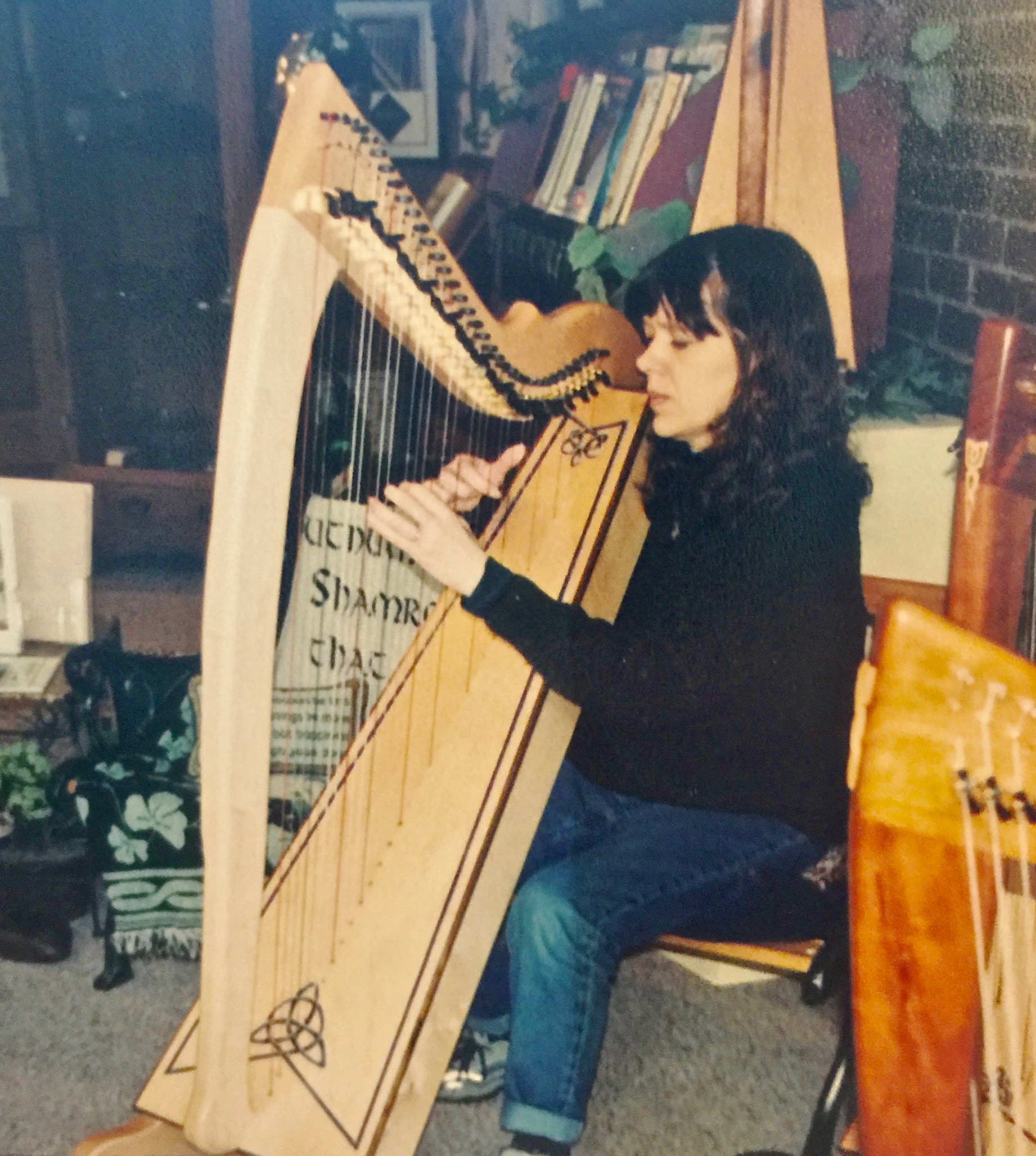 Kathleen Dlabick trying out a Corlieu Falls Harp in our showroom.