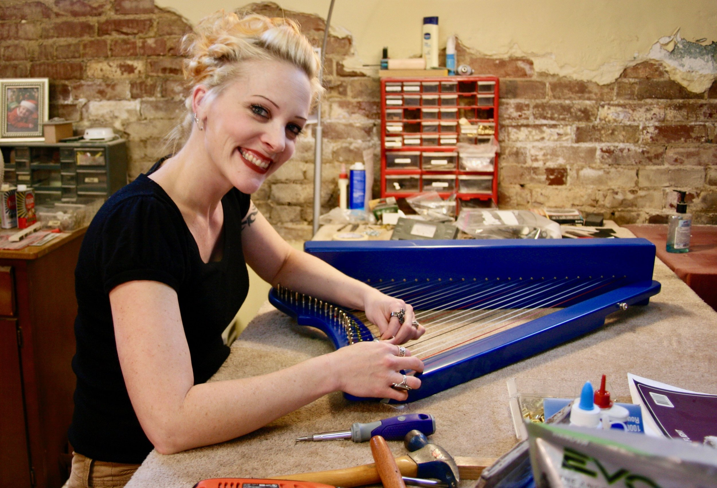 Rebecca Brown adding sharping levers to a Fullsicle Harp.