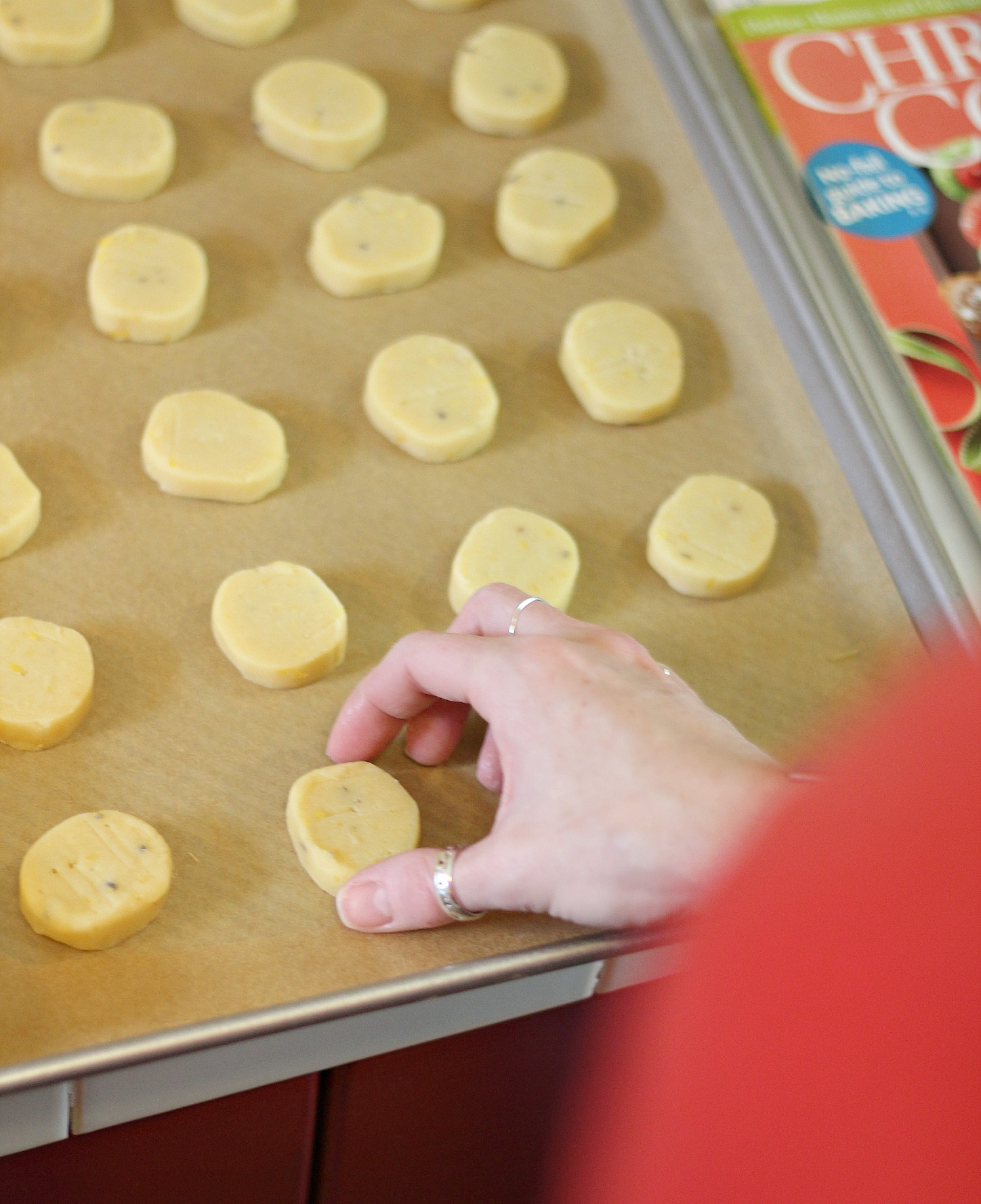 Placing the shortbread dough rounds on parchment for baking.