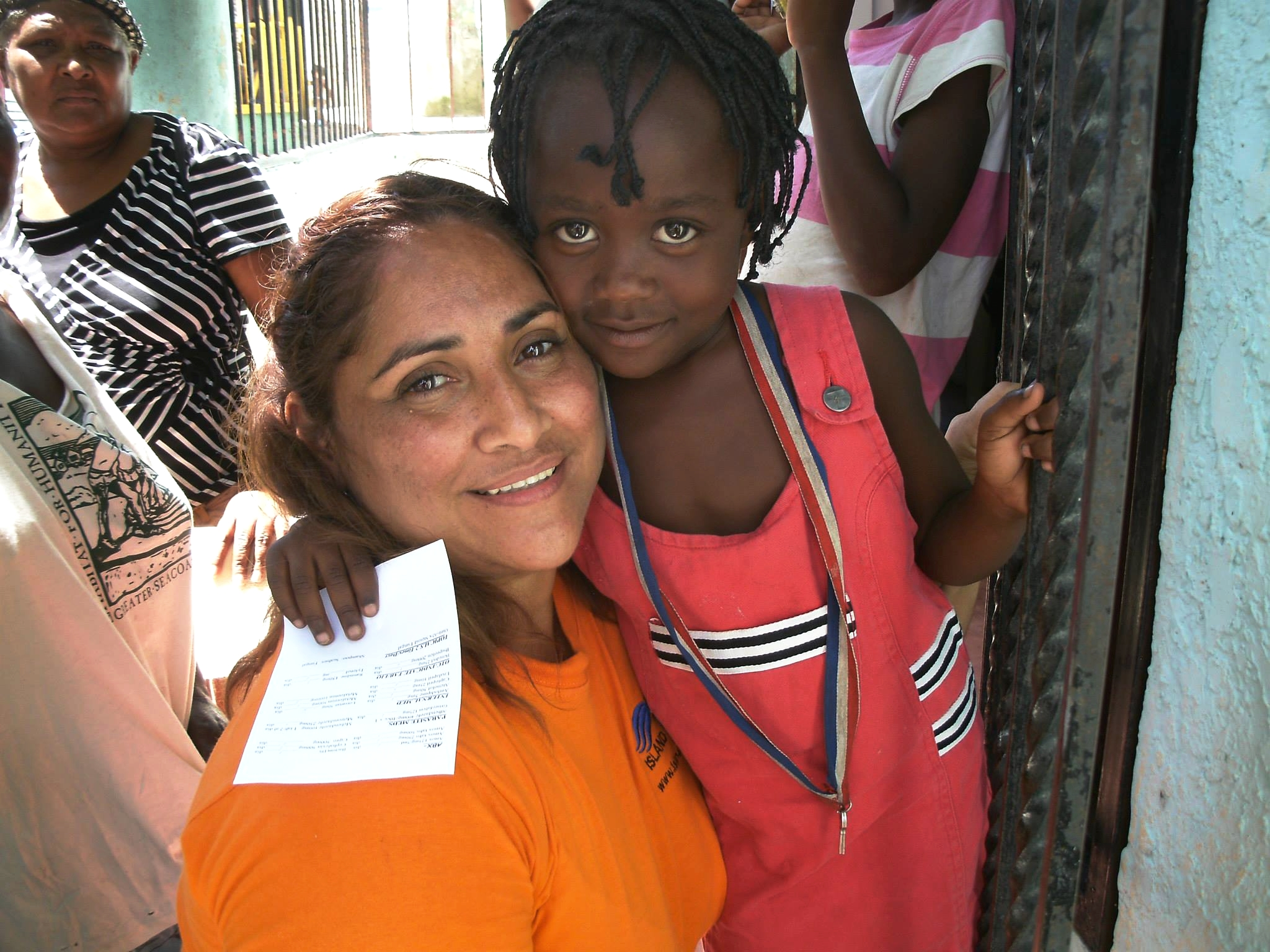 suzy from island impact with small haitian child.jpg