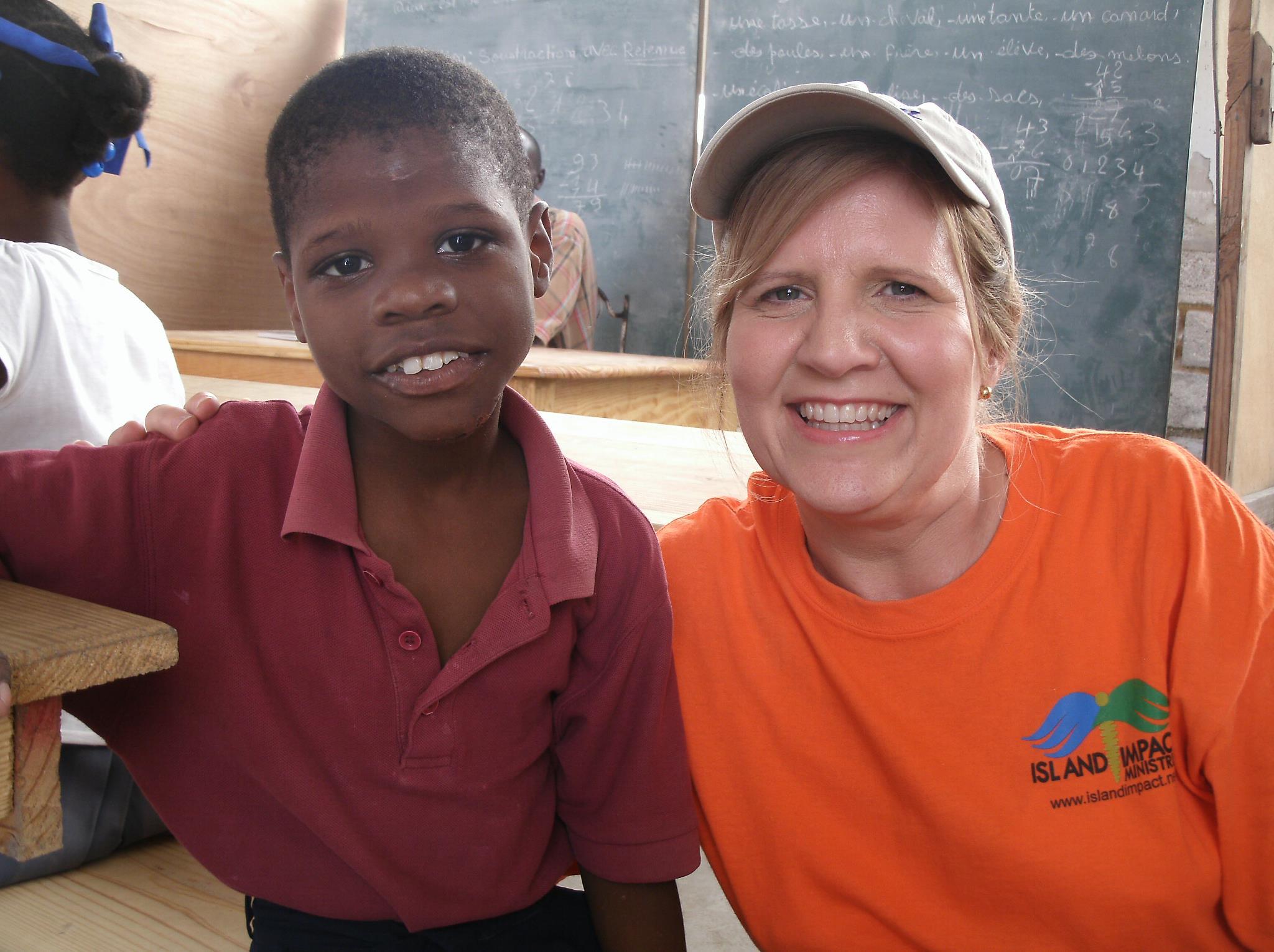 team member with haitian kid.jpg