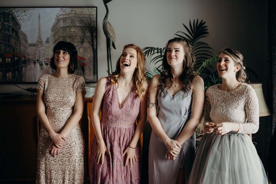 Kathryn's bridesmaids reacting to seeing her in her dress for the first time as she gracefully descended the stairs. We set it up in the dining room and moved some furniture around so that we could have lots of space with natural lighting.
