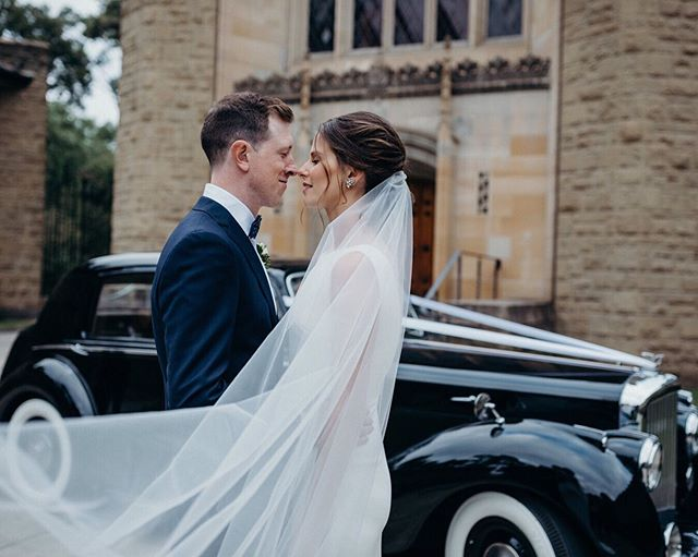 This photograph has a vintage quality to it: standing outside an old church, next to a 1950s car. Are you a retro lover? Or are your tastes more modern, minimalistic, bohemian, rustic, or playful? ⠀⠀⠀⠀⠀⠀⠀⠀⠀ Brainstorm locations for your photo session. What themes come up in your ideas? Start with the places that are important to your relationship, but also consider the aesthetic that you're drawn to. Don't write off a location because it's unusual. Your environment is an important part of your personal expression. ⛪️