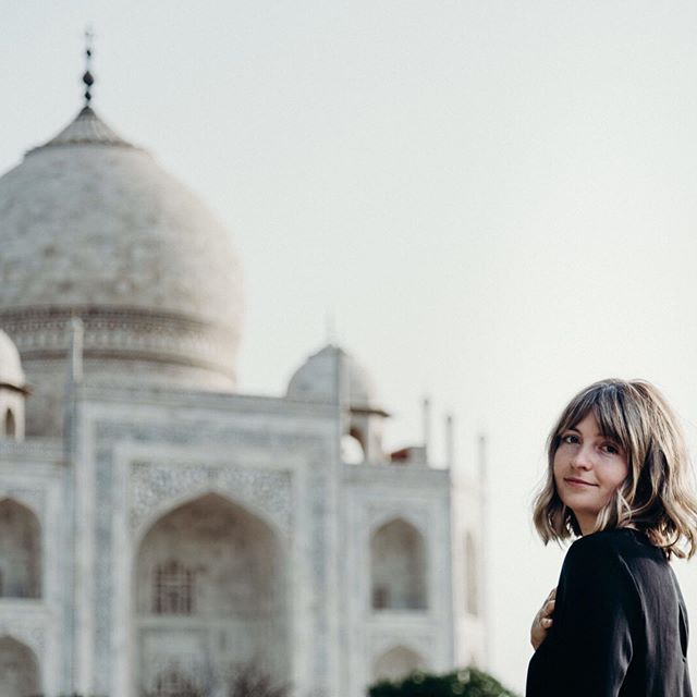 Is the Taj Mahal on your must-visit list? ⠀⠀⠀⠀⠀⠀⠀⠀⠀ Evan almost passed on making the 3-hour drive fearing it would just be another tourist trap, but we're glad we went. There's a reason it's a World Wonder. The construction, symmetry, and detailing were absolutely awe-inspiring. ⠀⠀⠀⠀⠀⠀⠀⠀⠀ If you do get a chance to visit, we suggest you do two things: 1) go at sunrise before the mid-day heat burns you alive, and 2) hire a tourist photographer from the courtyard to take your photos. ⠀⠀⠀⠀⠀⠀⠀⠀⠀ We hired a guy who set us up in the most hilarious poses (Swipe to see!). Photography culture in India is quite different than what we're used to, but it was a fun experience. 🕌