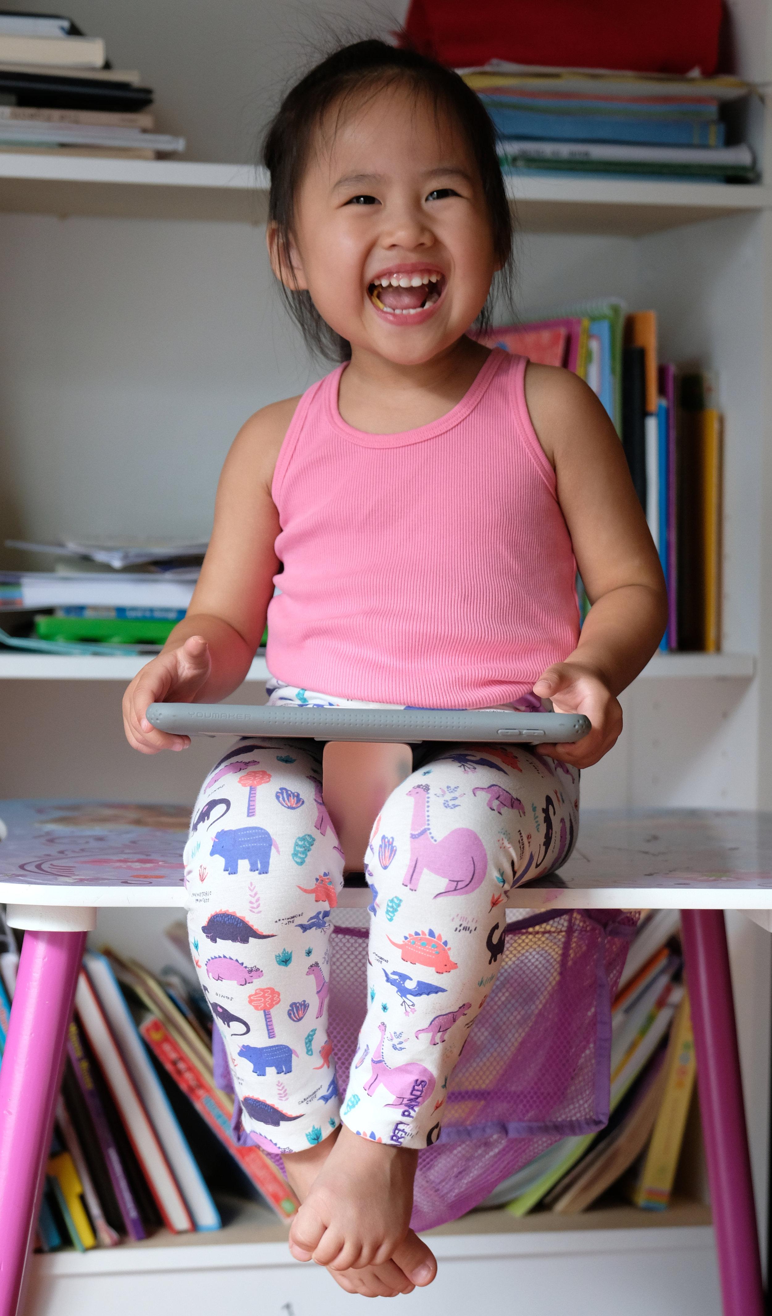 My little one enjoying her  Ipad  wearing her  Smartypants Leggings .