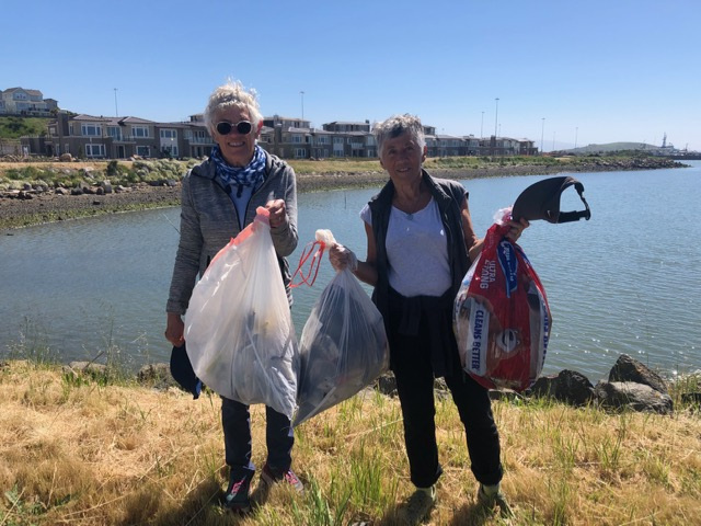 Janis Pearson and Elsa Tranter clean up at Sandpiper Spit in Richmond. Photo by Kay Englund.