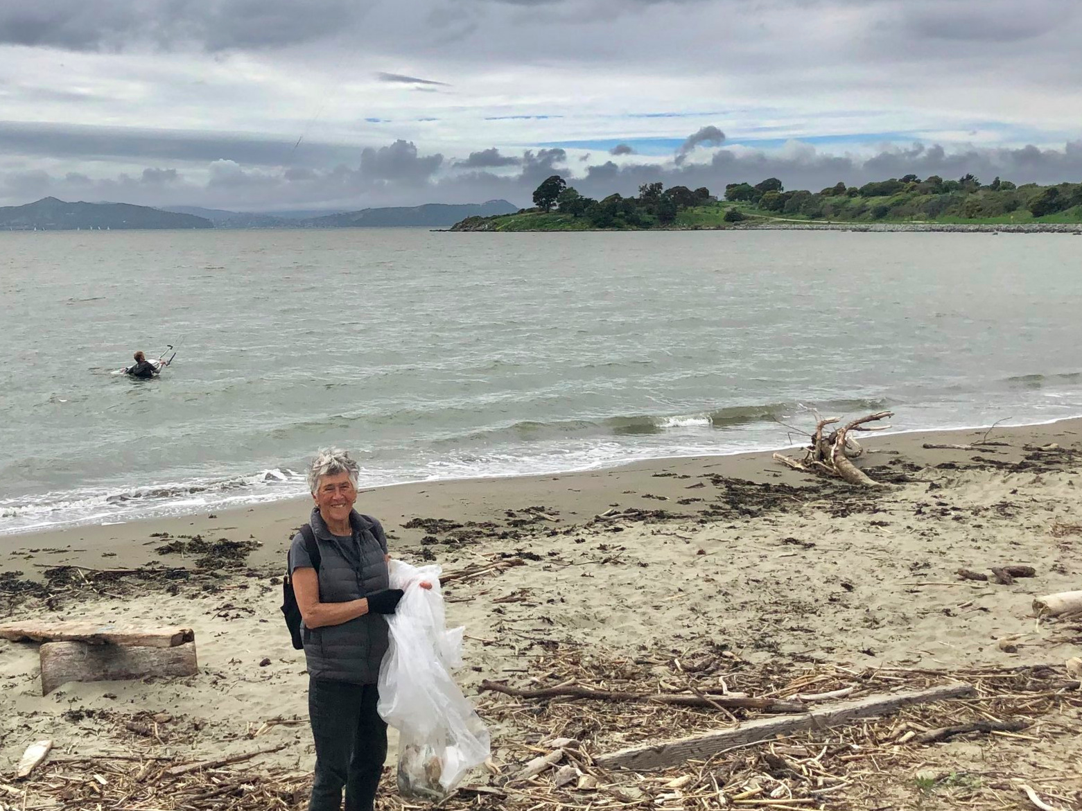 Elsa Tranter cleans up the Berkeley Beach. Photo by Colleen Neff.
