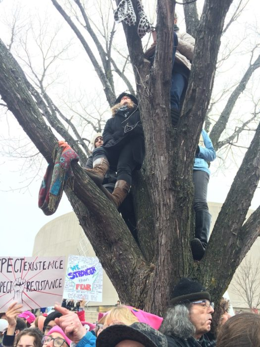 It was so crowded that women were climbing the trees to see.