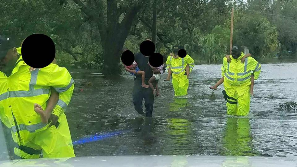 Photo courtesy of City of Brunswick Police Department via Facebook of officers taking residents to safety after Irma