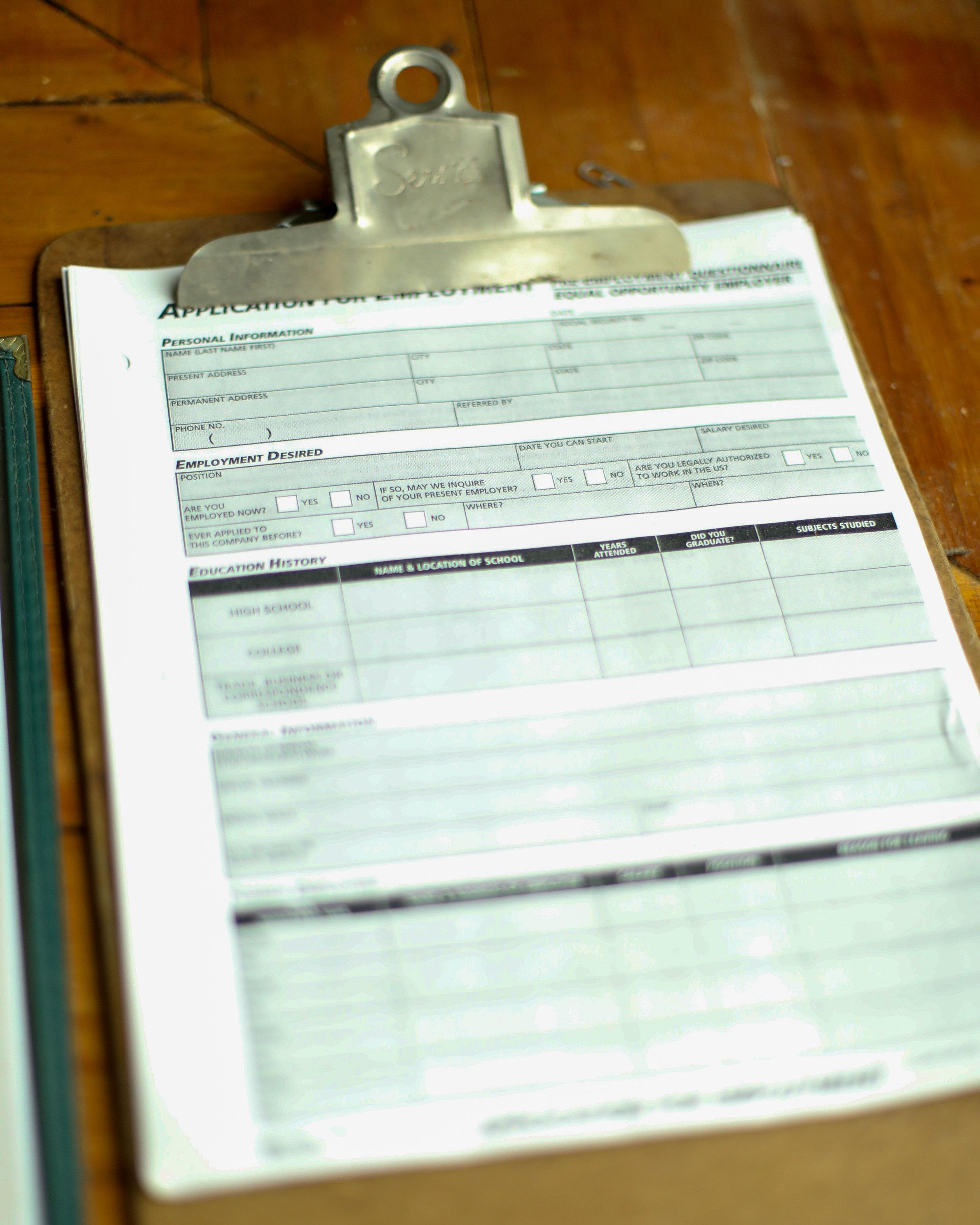 An application form on a clipboard