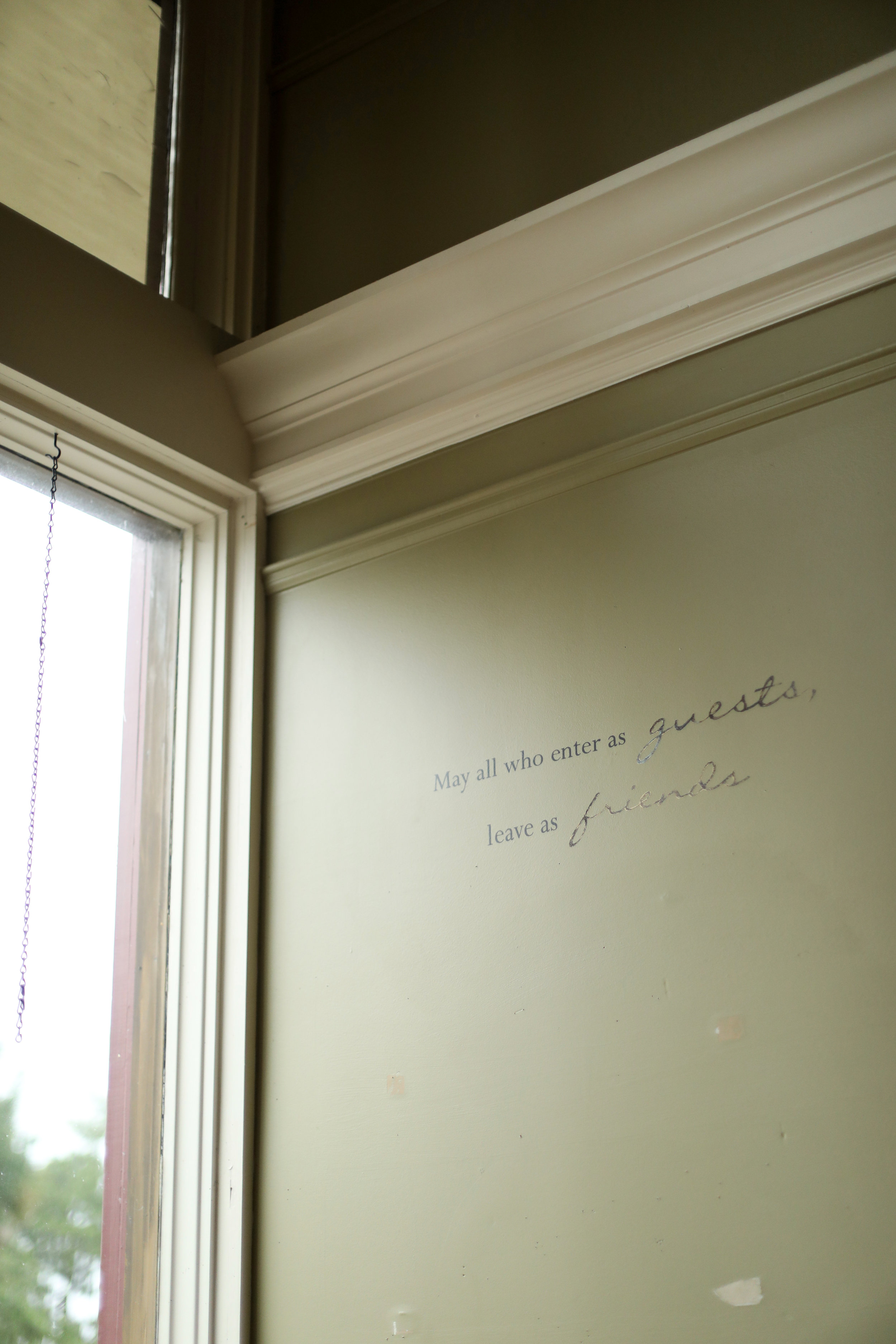 Writing on a wall at Strong Roots Provisions