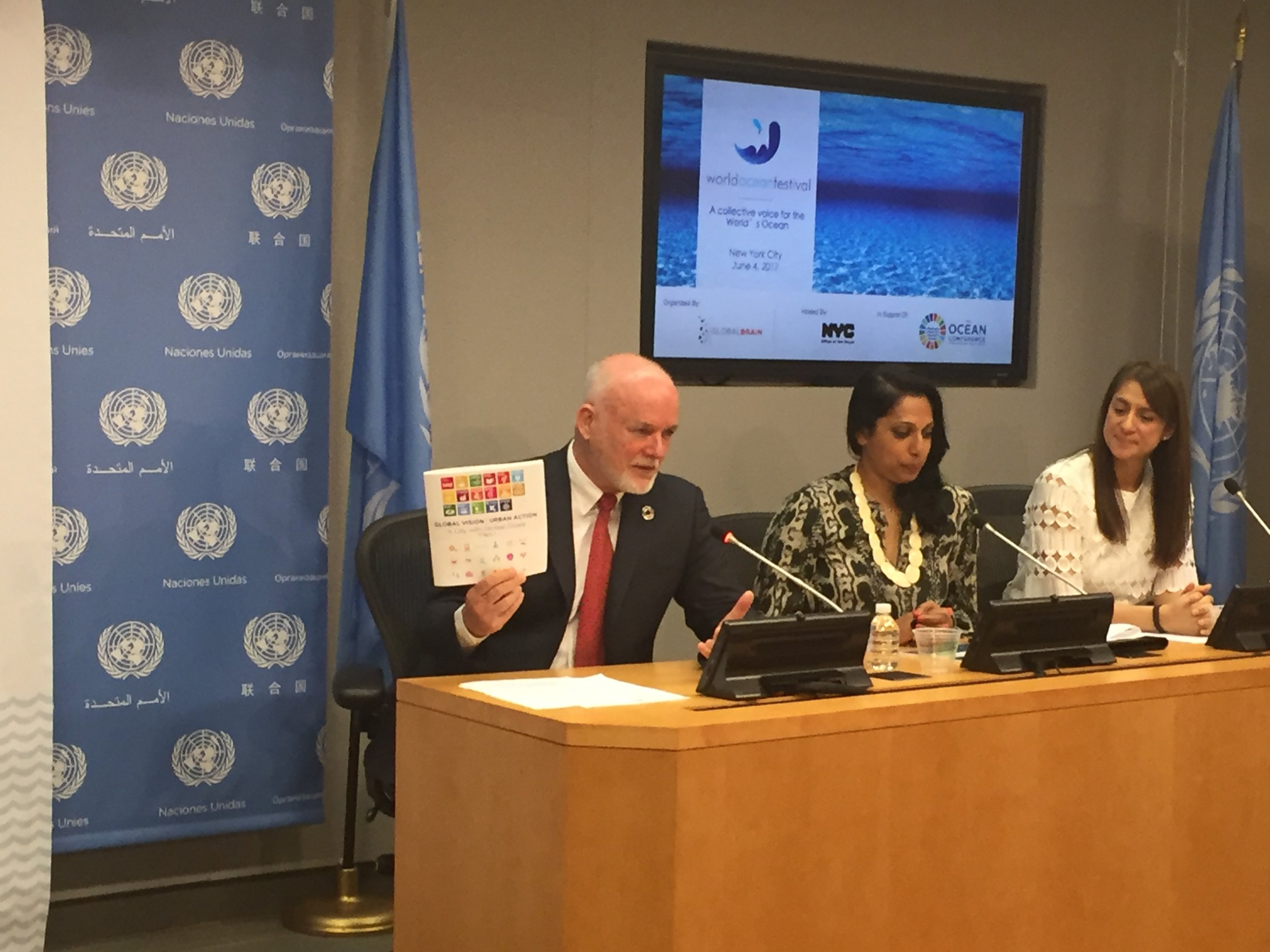 At the World Ocean Festival announcement, President of the UN General Assembly, Ambassador Peter Thomson, showcased the Office for International Affairs' A City with Global Goals booklet that maps the synergies between the UN Sustainable Development Goals and OneNYC. From L to R: Ambassador Peter Thomson, President, UN General Assembly; Penny Abeywardena, Commissioner, Mayor's Office for International Affairs; Natalia Vega-Berry, Founder/CEO, Global Brain