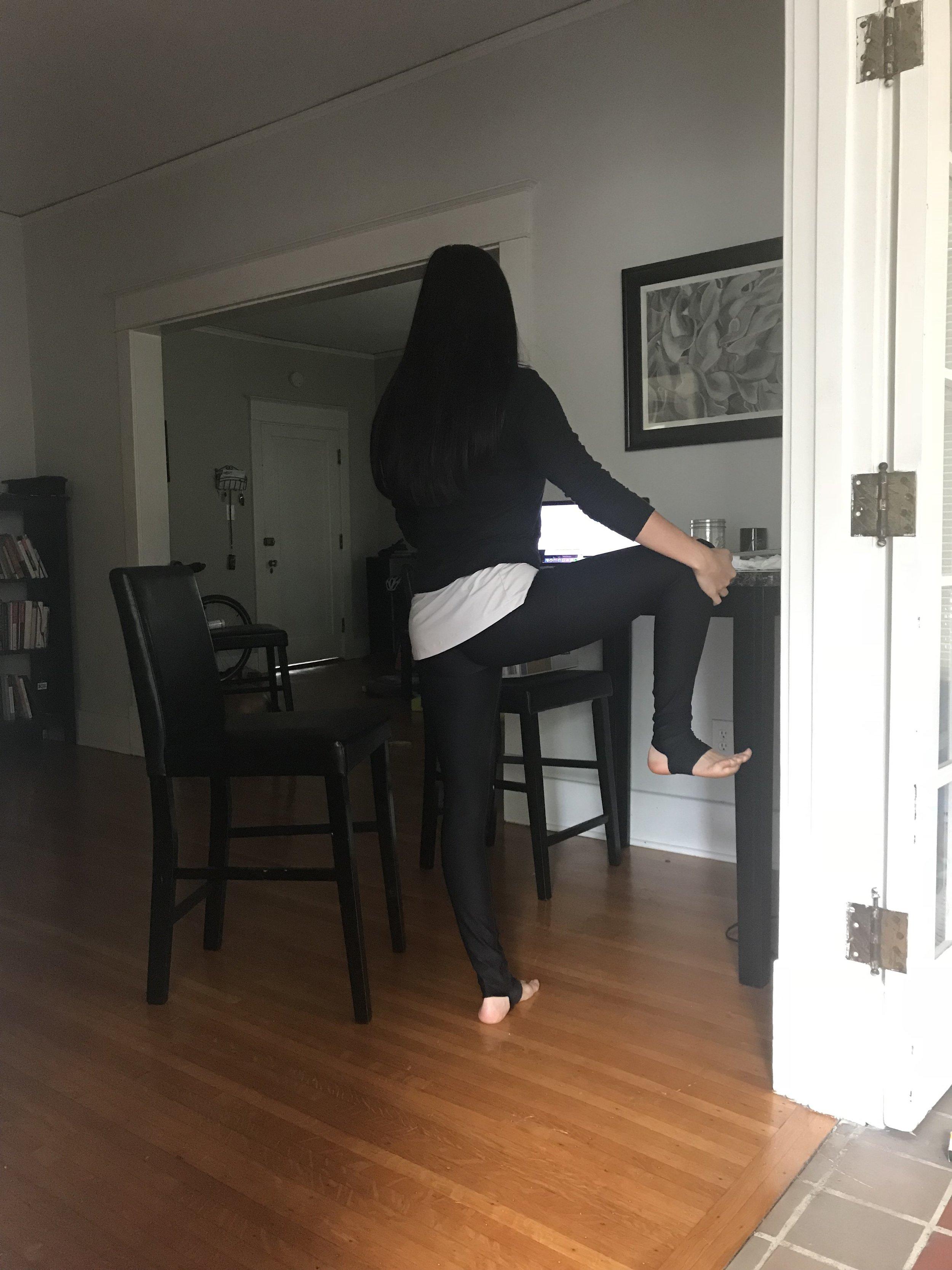 Hailey Heishman extended leg raise pose