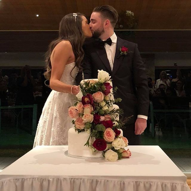 S & Z's amazing cake and the beautiful couple! #murleywedding #weddingcake #cakeflowers #melbourneweddingflorist #weddingflowers