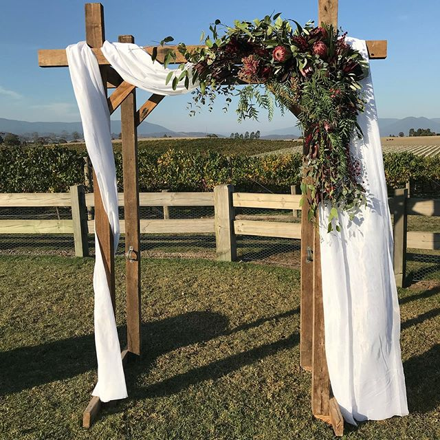 S' beautiful ceremony arch @zonzoestate #nofilter #nativeflowers #floralarch #ceremonyarch #melbourneweddingflorist #weddingflowers